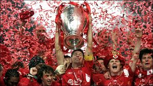 Steven Gerrard holds the UEFA Champions League trophy aloft after his team produces a stunning comeback from three goals down to beat AC Milan on penalties in the  Final on May 25 2005