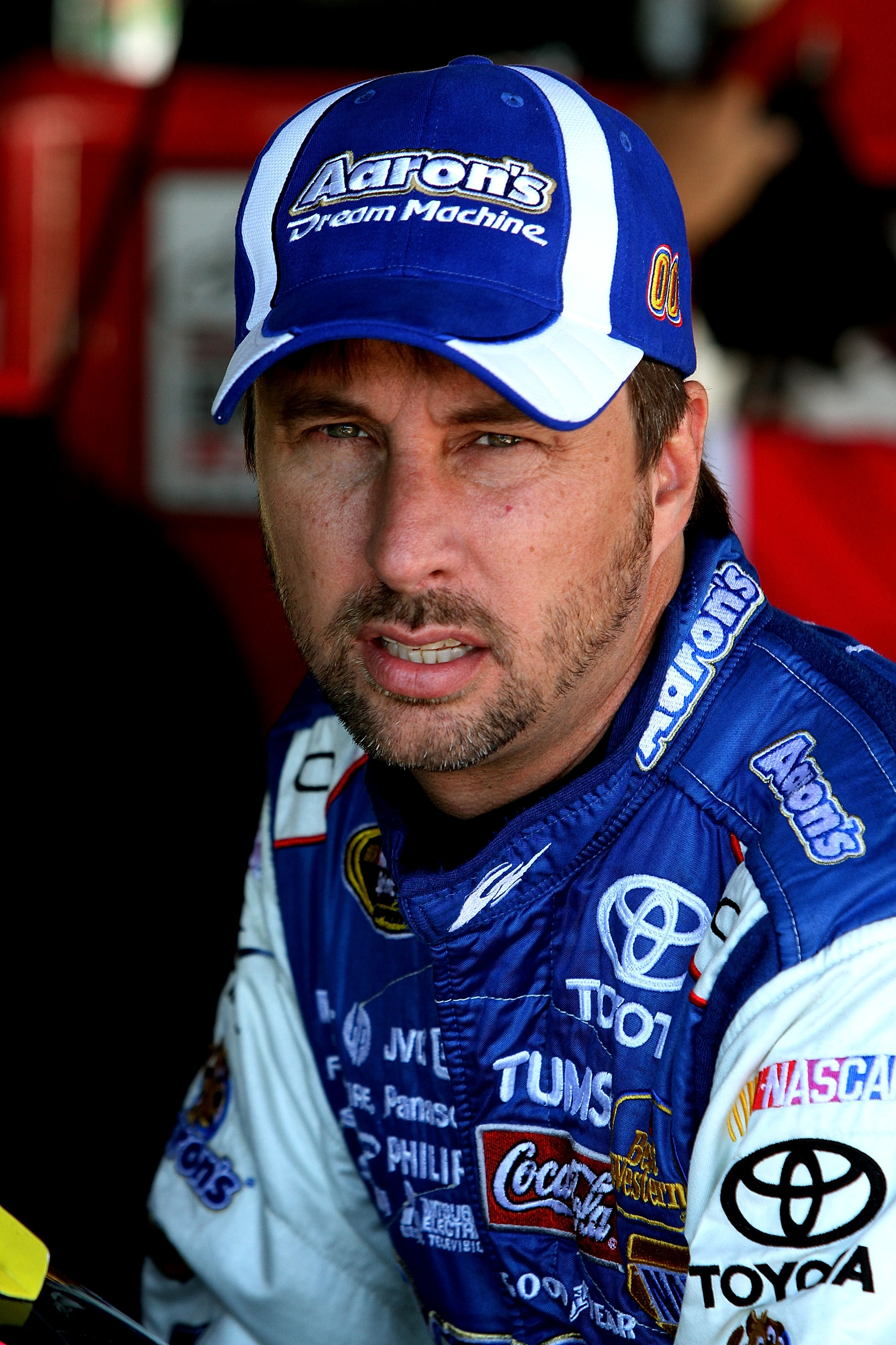 RICHMOND, VA - SEPTEMBER 10: David Reutimann, driver of the #00 Aaron's Dream Machine Toyota, waits in the garage during practice for the NASCAR Sprint Cup Series Air Guard 400 at Richmond International Raceway on September 10, 2010 in Richmond, Virginia.