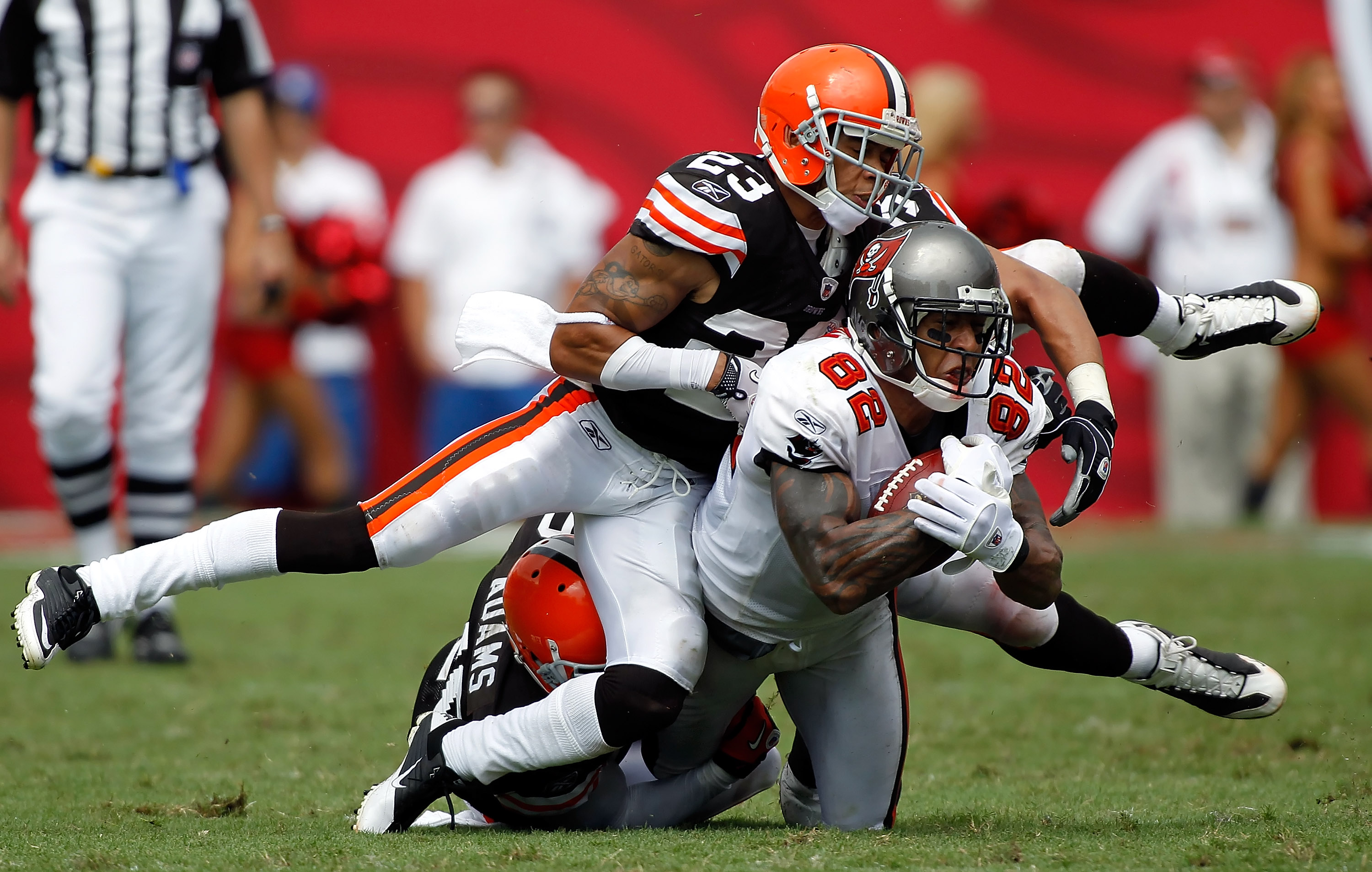 TAMPA, FL - SEPTEMBER 12:  Tight end Kellen Winslow #82 of the Tampa Bay Buccaneers is tackled by defenders Joe Haden #23 and Mike Adams #20 of the Cleveland Browns during the season opener game at Raymond James Stadium on September 12, 2010 in Tampa, Flo