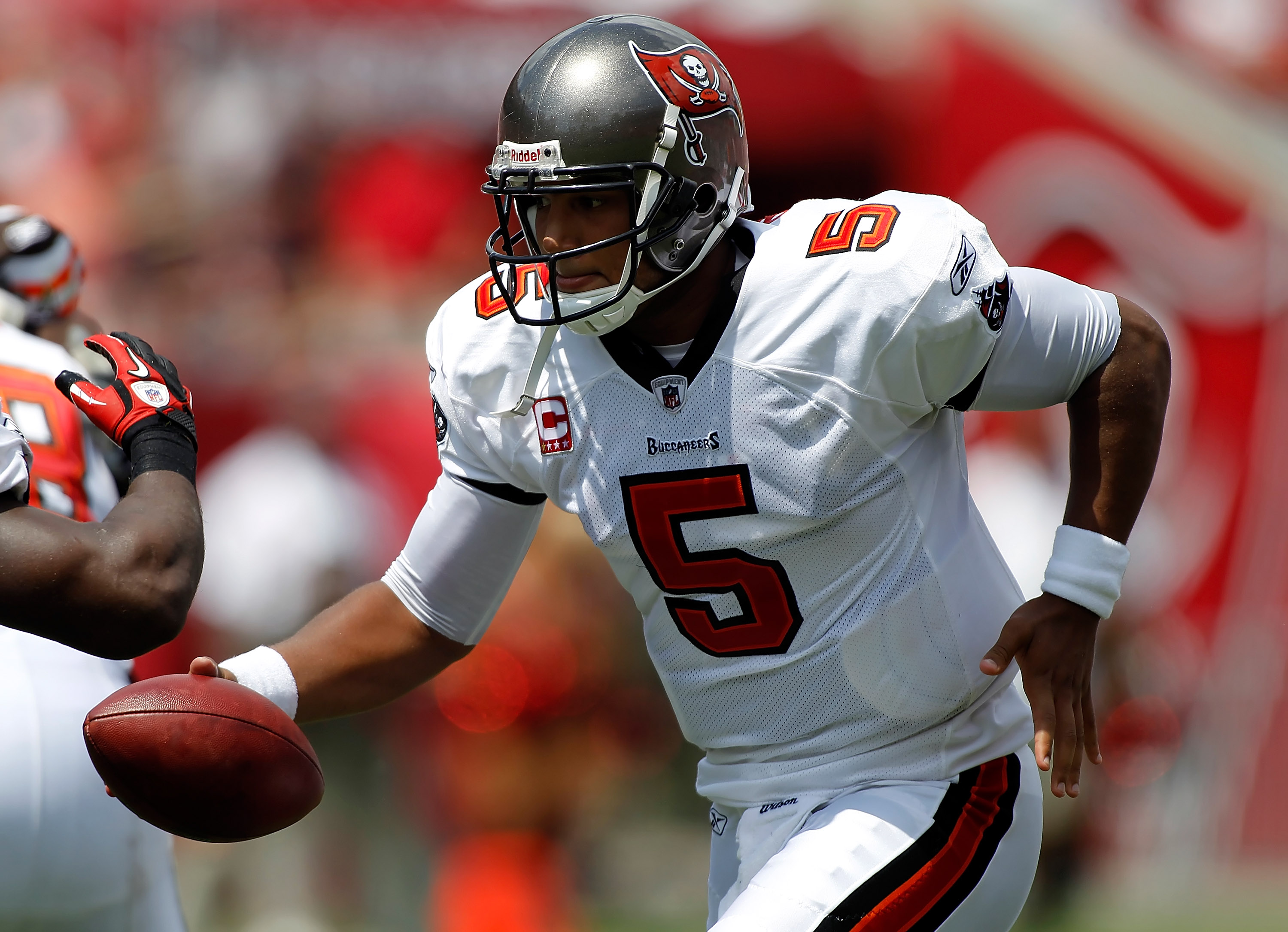 TAMPA, FL - SEPTEMBER 12:  Quarterback Josh Freeman #5 of the Tampa Bay Buccaneers hands the ball off against the Cleveland Browns during the NFL season opener game at Raymond James Stadium on September 12, 2010 in Tampa, Florida.  (Photo by J. Meric/Gett