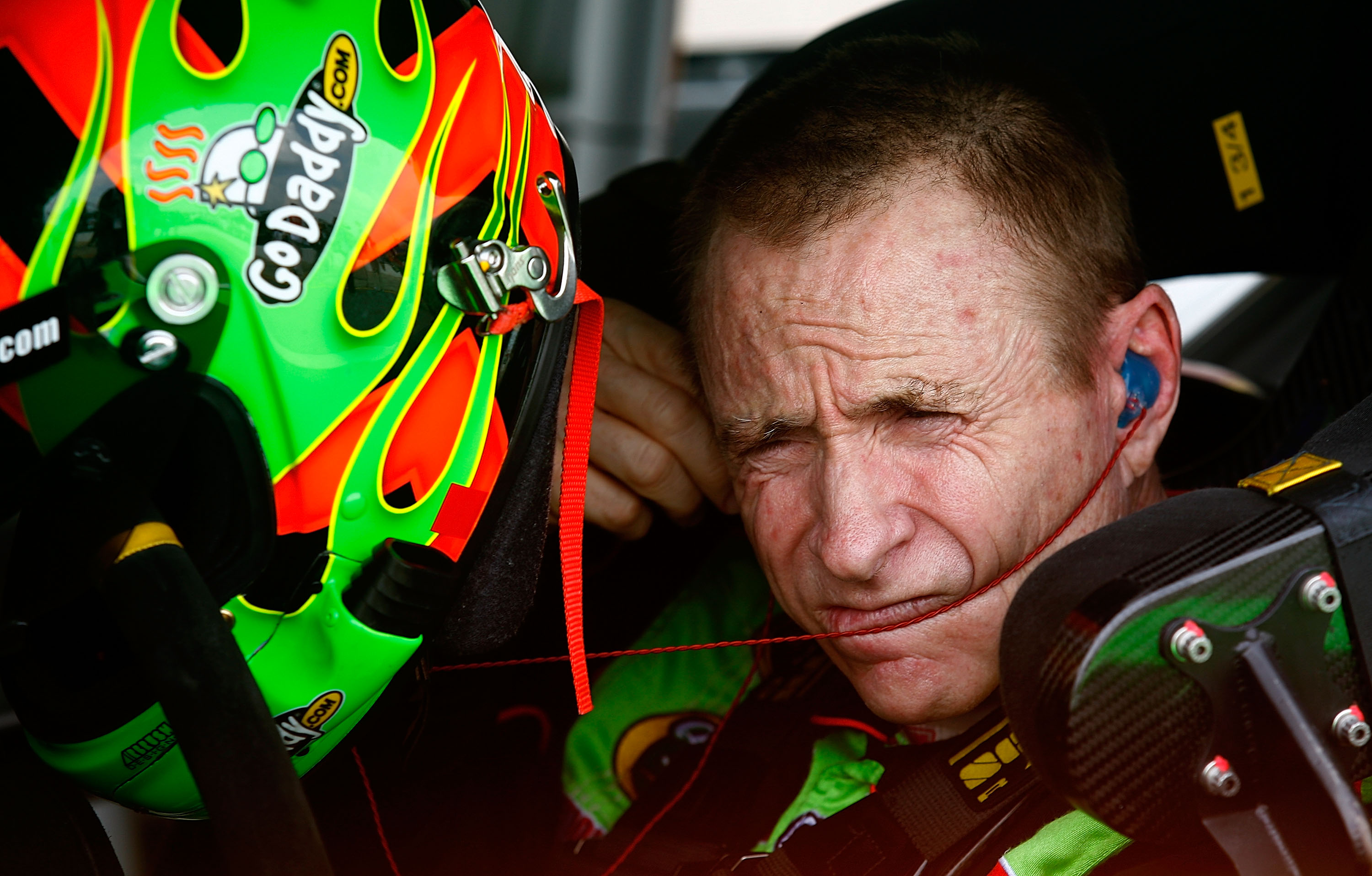 BROOKLYN, MI - AUGUST 13:  Mark Martin, driver of the #5 GoDaddy.com Chevrolet, makes adjustments in his car during qualifying for the NASCAR Sprint Cup Series CARFAX 400 at Michigan International Speedway on August 13, 2010 in Brooklyn, Michigan.  (Photo