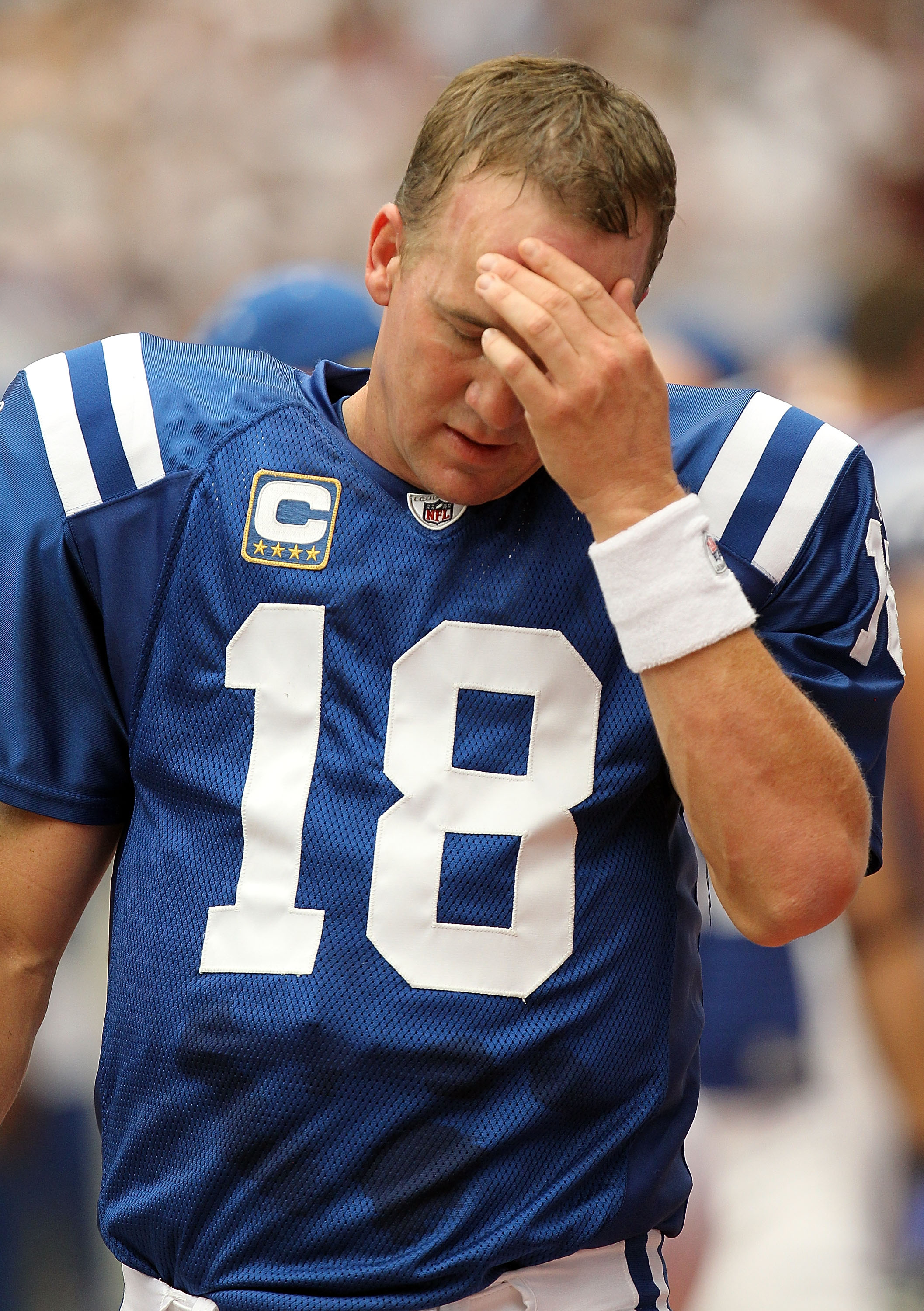 HOUSTON - SEPTEMBER 12:  Quarterback Peyton Manning #18 of the Indianapolis Colts reacts on the sidelines during the NFL season opener against the Houston Texans at Reliant Stadium on September 12, 2010 in Houston, Texas.  (Photo by Ronald Martinez/Getty
