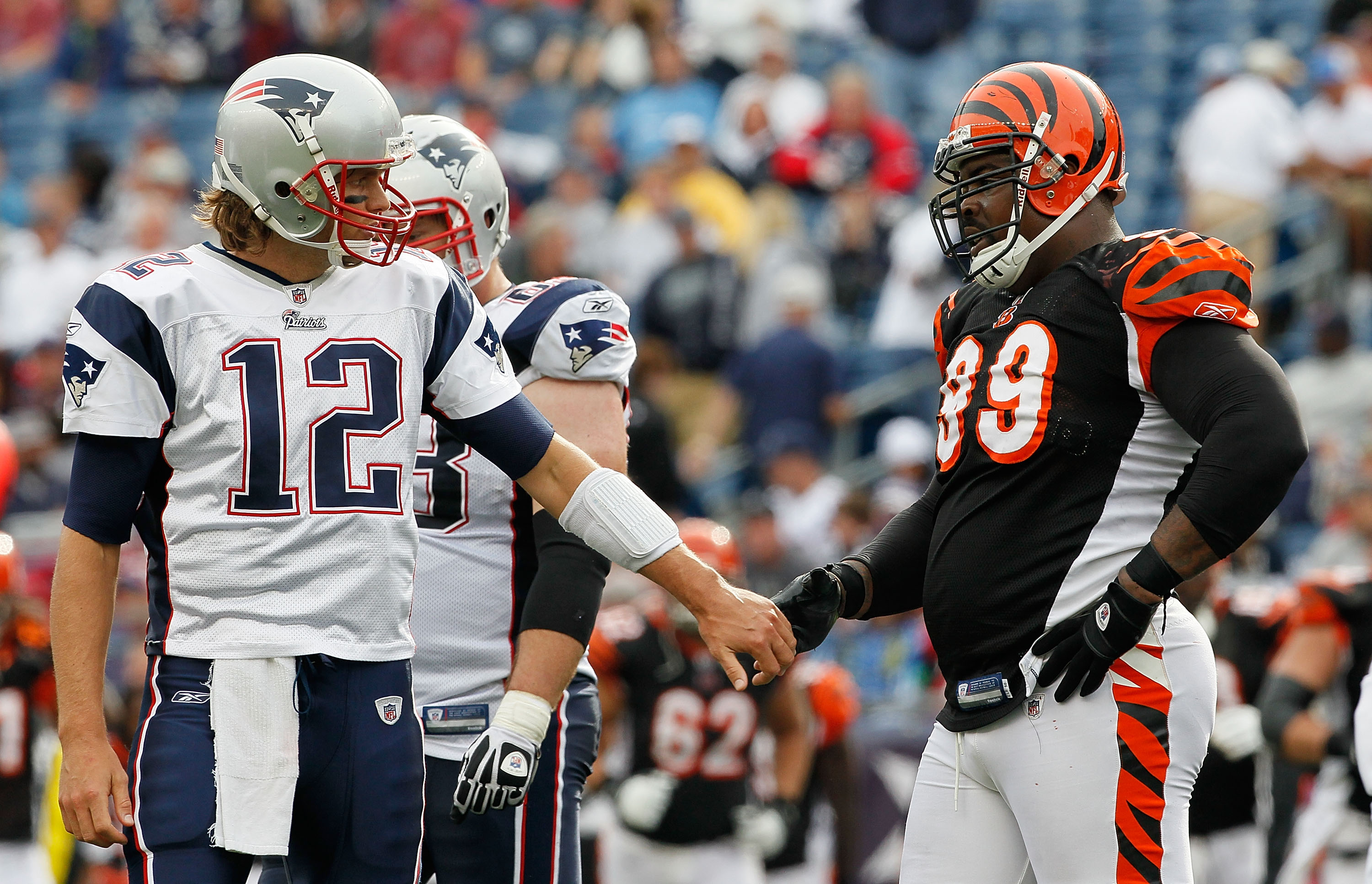 FOXBORO, MA - SEPTEMBER 12: Quarterbacks Tom Brady #12 of the New England Patriots shakes hands with Tank Johnson #99 of the Cincinnati Bengals during a the NFL season opener against the Cincinnati Bengals at Gillette Stadium on September 12, 2010 in Foxb