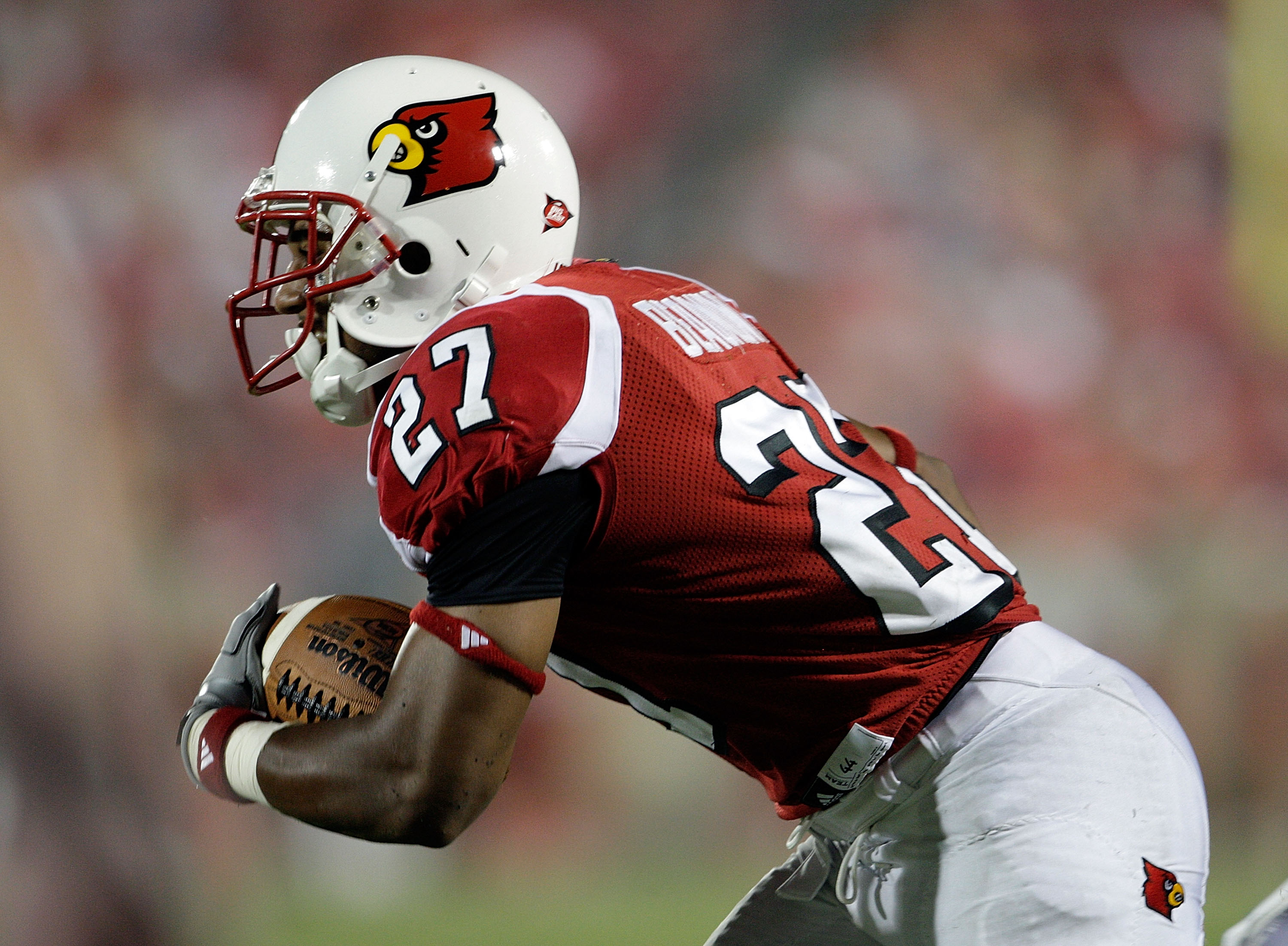 LOUISVILLE, KY - SEPTEMBER 05:  Doug Beaumont #27 of the Louisville Cardinals runs with the ball after a reception during the game against the Indiana State Sycamores at Papa John's Cardinal Stadium on September 5, 2009 in Louisville, Kentucky.  (Photo by