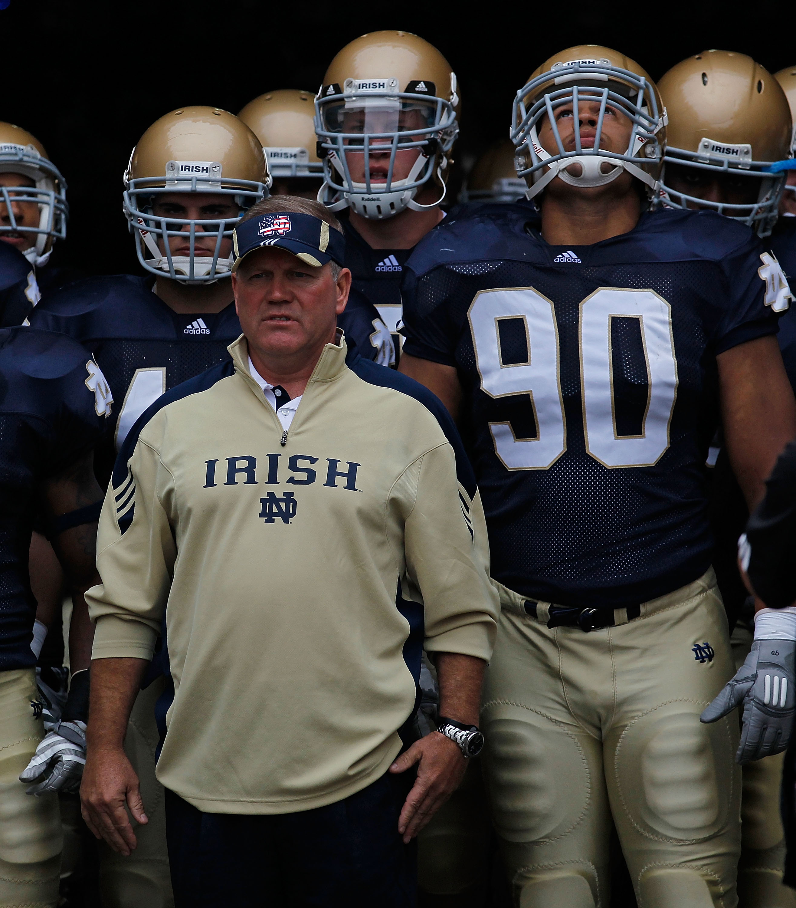 SOUTH BEND, IN - SEPTEMBER 11: Head coach Brian Kelly of the Notre Dame Fighting Irish waits to enter the field with his team including Carlo Calabrese #44 and Ethan Johnson #90 before a game against the Michigan Wolverines at Notre Dame Stadium on Septem
