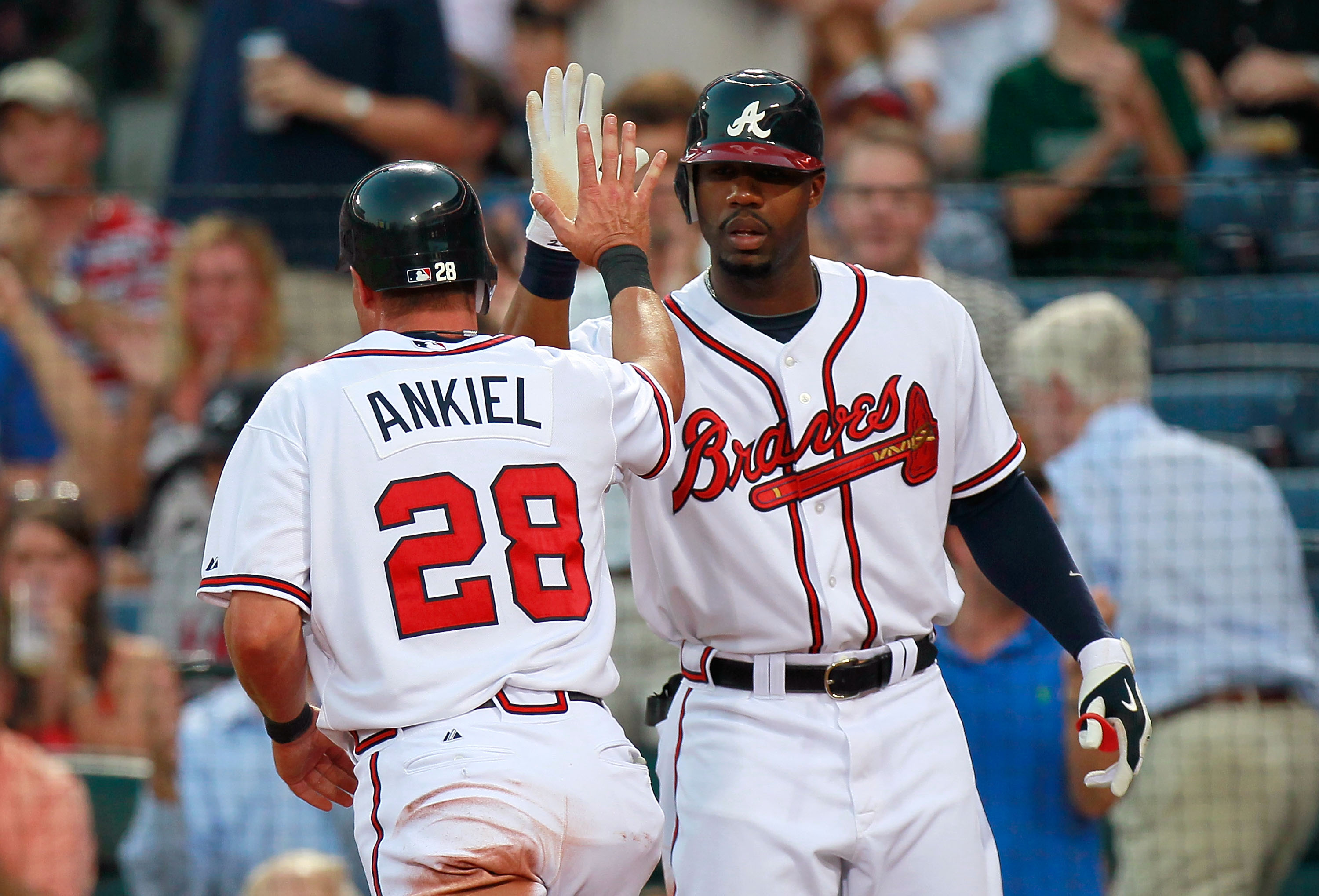 ATLANTA - SEPTEMBER 01:  Jason Heyward #22 of the Atlanta Braves congratulates Rick Ankiel #28 after Ankiel scored against the New York Mets at Turner Field on September 1, 2010 in Atlanta, Georgia.  (Photo by Kevin C. Cox/Getty Images)