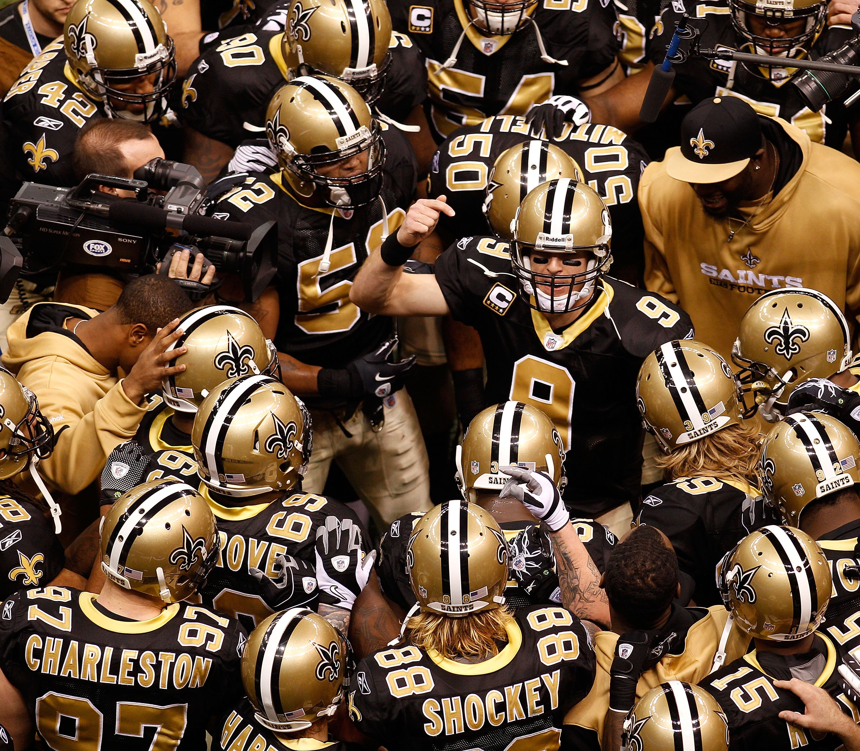 NEW ORLEANS - JANUARY 24:  Quarterback Drew Brees #9 of the New Orleans Saints addresses his teammates prior to playing against the Minnesota Vikings during the NFC Championship Game at the Louisiana Superdome on January 24, 2010 in New Orleans, Louisiana