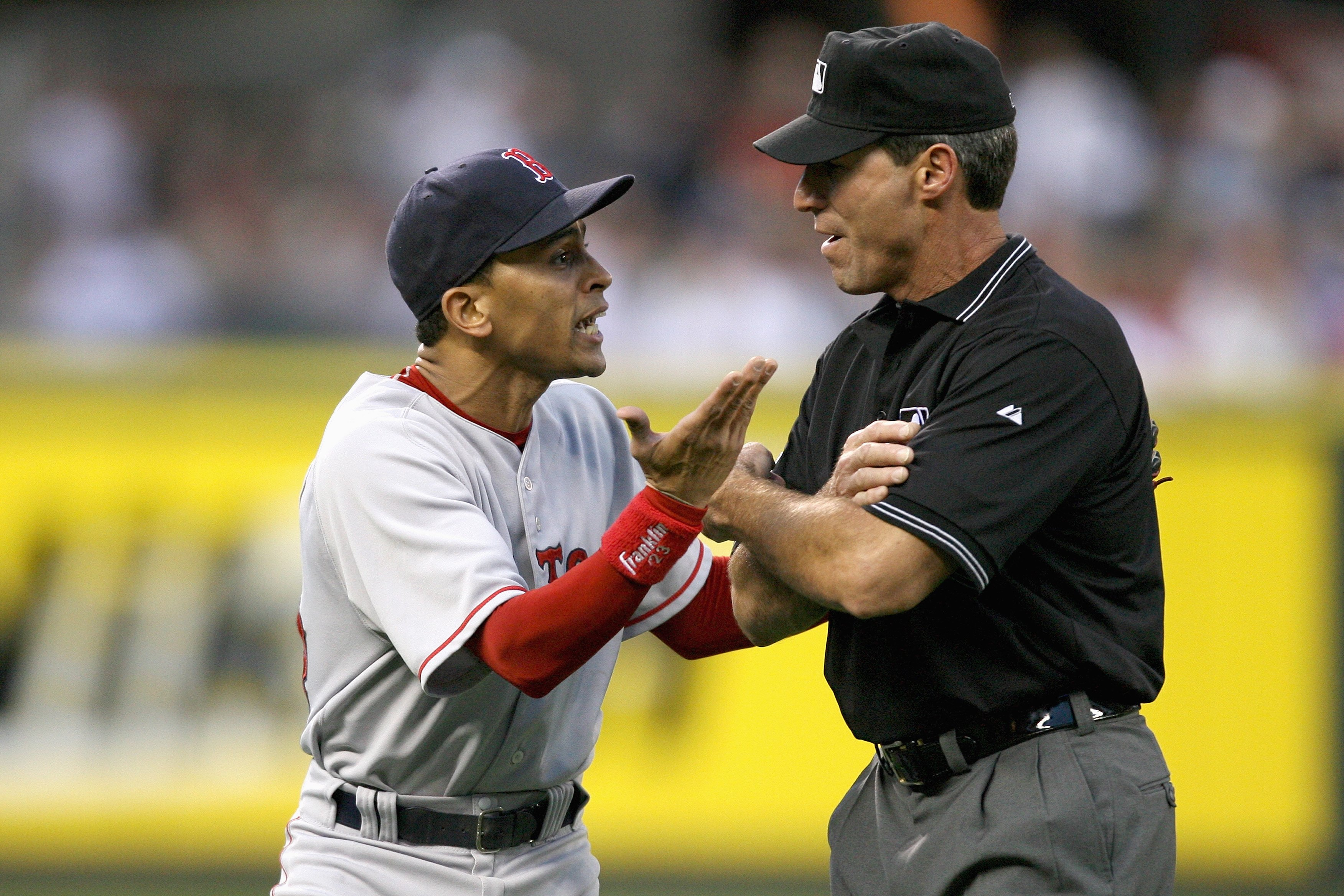 SEATTLE - MAY 27: Shortstop Julio Lugo #23 of the Boston Red Sox argues with third base umpire Angel Hernandez after being ejected in the fifth inning against the Seattle Mariners May 27, 2008 at Safeco Field in Seattle, Washington. (Photo by Otto Greule