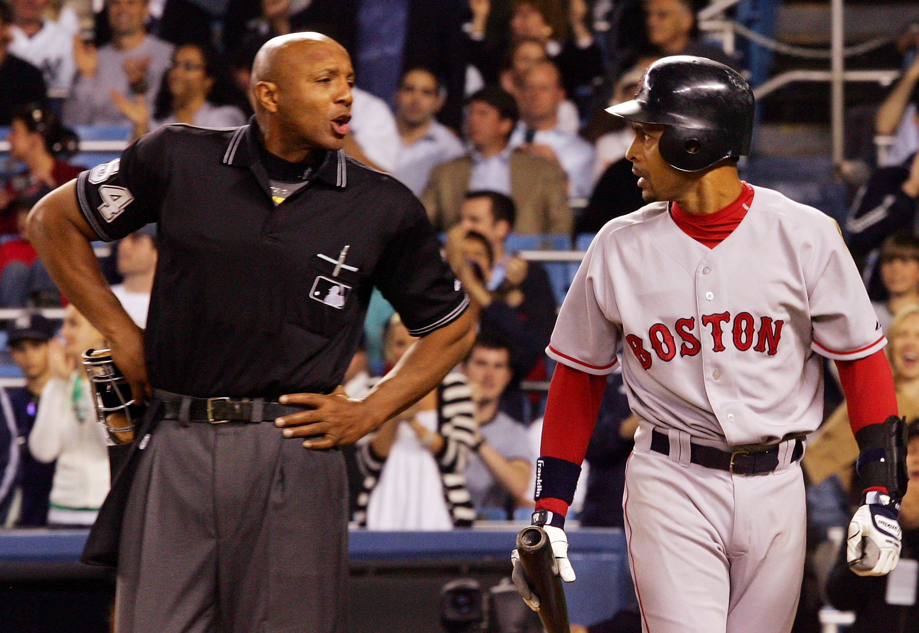 NEW YORK - MAY 23: Julio Lugo #23 of the Boston Red Sox argues a call with home plate umpire C.B. Bucknor in the ninth inning against the New York Yankees at Yankee Stadium on May 23, 2007 in the Bronx borough of New York City.  (Photo by Jim McIsaac/Gett