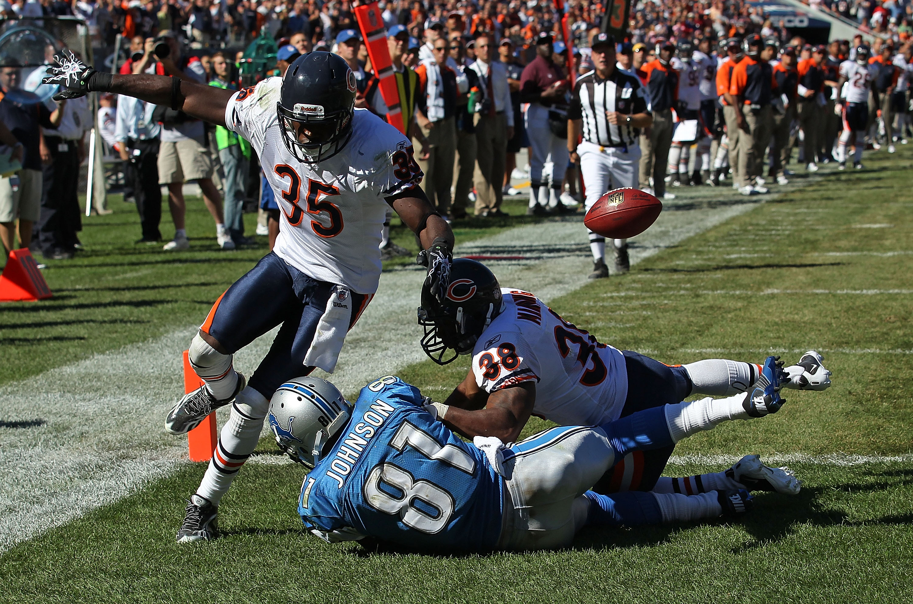 CHICAGO - SEPTEMBER 12: Zack Bowman #35 and Danieal Manning #38 of the Chicago Bears break up a pass intended for Calvin Johnson #81 of the Detroit Lions during the NFL season opening game at Soldier Field on September 12, 2010 in Chicago, Illinois. The B