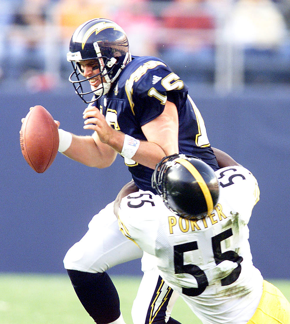 24 Dec 2000:  Quarterback Ryan Leaf #16 of the San Diego Chargers is sacked by Joey Porter #55 of the Pittsburgh Steelers during their game at Qualcomm Stadium in San Diego, California.  DIGITAL IMAGE Mandatory Credit: Stephen Dunn/ALLSPORT