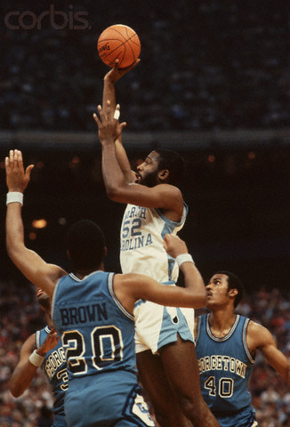 James Worthy reminds Georgetown's Fred Brown who he plays for.