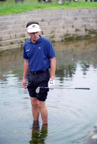 French golfer Jean Van de Velde wades into Barry Burn by the 18th green after his 3rd shot went astray in the final round of the British Open Championship at Carnoustie, Scotland, 18th July 1999. Having arrived at the 18th tee with a three-shot lead, Van