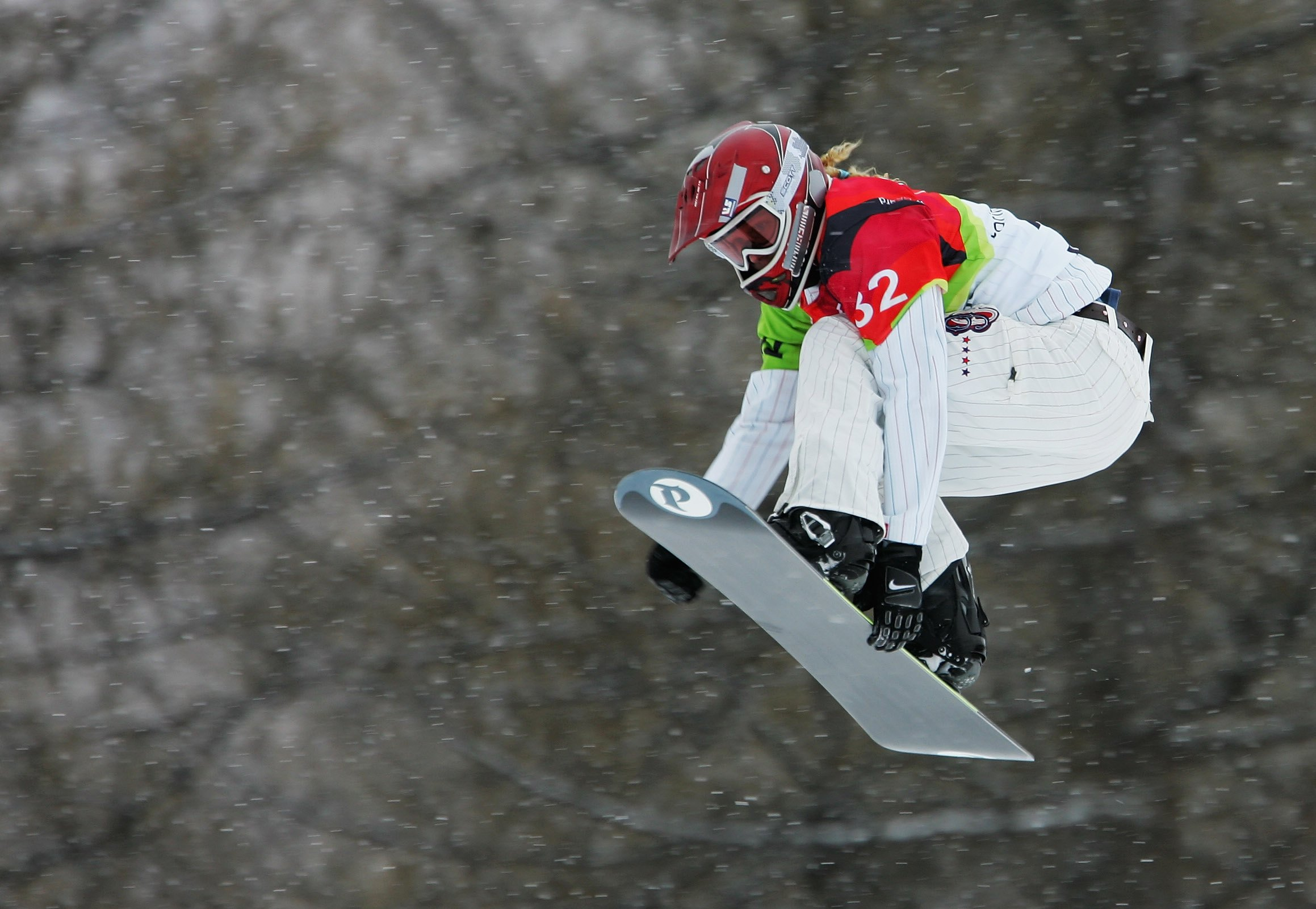 BARDONECCHIA, ITALY - FEBRUARY 17:  Lindsey Jacobellis of the United States competes in the Womens Snowboard Cross Qualifying on Day 7 of the 2006 Turin Winter Olympic Games on February 17, 2006 in Bardonecchia, Italy.  (Photo by Clive Mason/Getty Images)