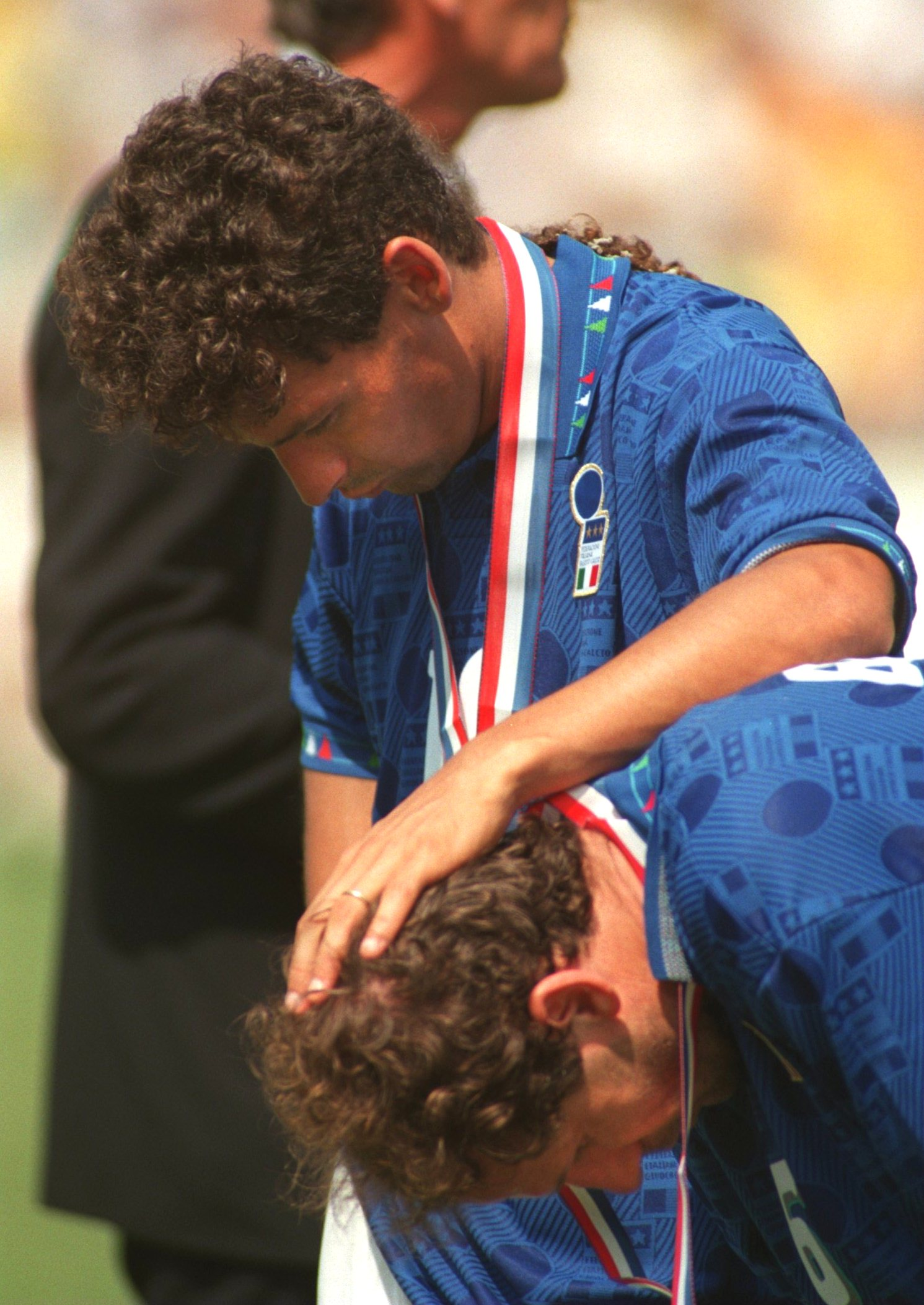 17 Jul 1994: ROBERTO BAGGIO CONSOLES THE ITALIAN CAPTAIN FRANCO BARESI AFTER THE 1994 WORLD CUP FINAL AT THE ROSE BOWL STADIUM IN PASADENA CALIFORNIA. BRAZIL WON THE WORLD CUP ON PENALTIES.