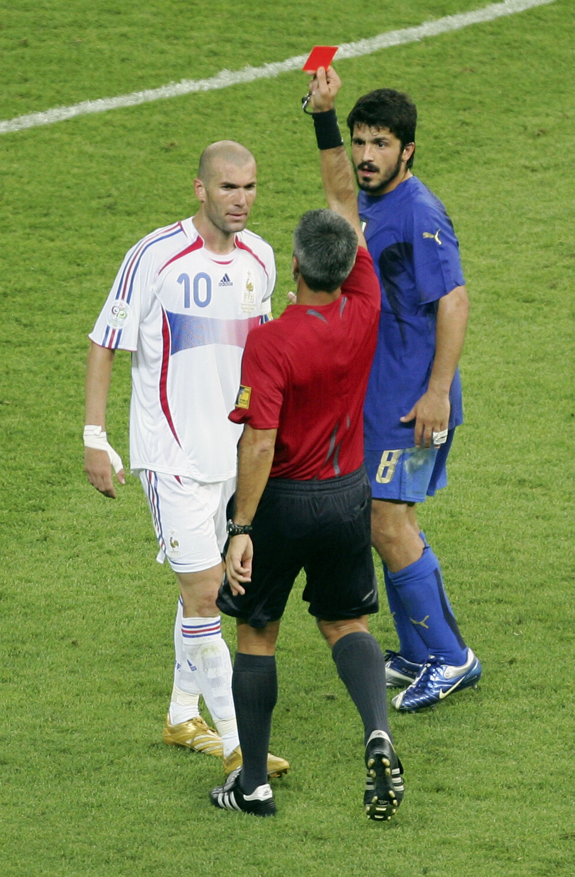 BERLIN - JULY 09:  Zinedine Zidane (L) of France is shown the red card by Referee Horacio Elizondo of Argentina as Gennaro Gattuso of Italy looks on during the FIFA World Cup Germany 2006 Final match between Italy and France at the Olympic Stadium on July