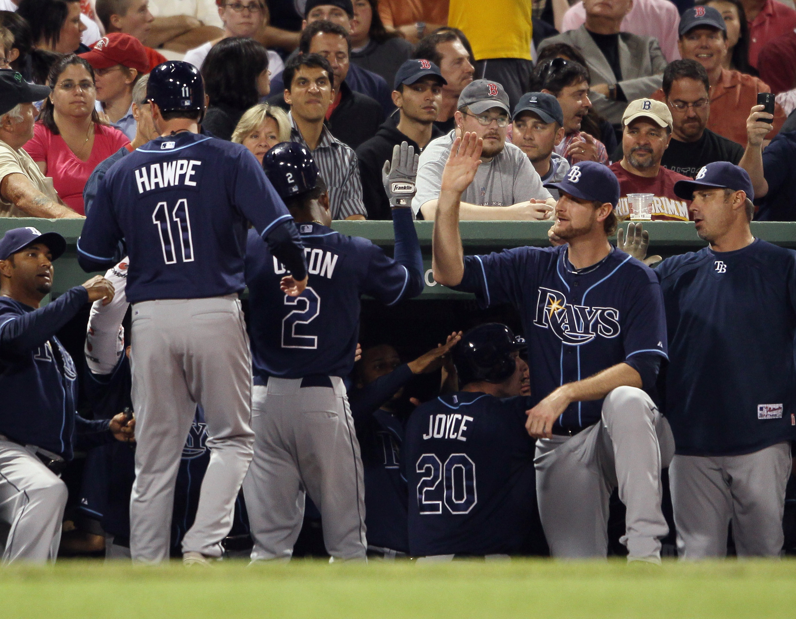 BOSTON - SEPTEMBER 08:  B.J. Upton #2 of the Tampa Bay Rays is congratulated by teamamtes after he hit a three run homer in the second inning against the Boston Red Sox defends on September 8, 2010 at Fenway Park in Boston, Massachusetts.  (Photo by Elsa/