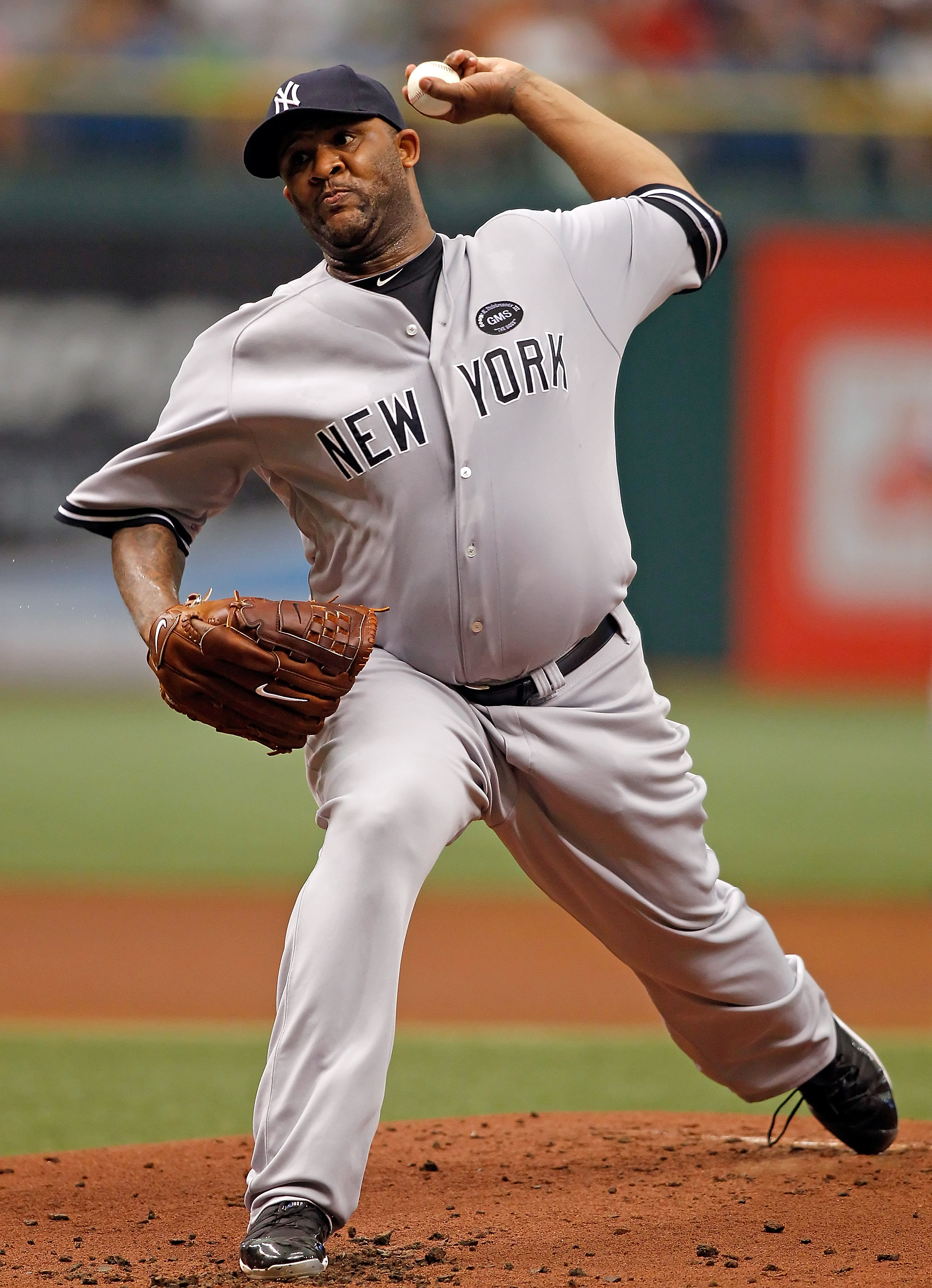 ST. PETERSBURG - AUGUST 01:  Pitcher CC Sabathia #52 of the New York Yankees pitches against the Tampa Bay Rays during the game at Tropicana Field on August 1, 2010 in St. Petersburg, Florida.  (Photo by J. Meric/Getty Images)