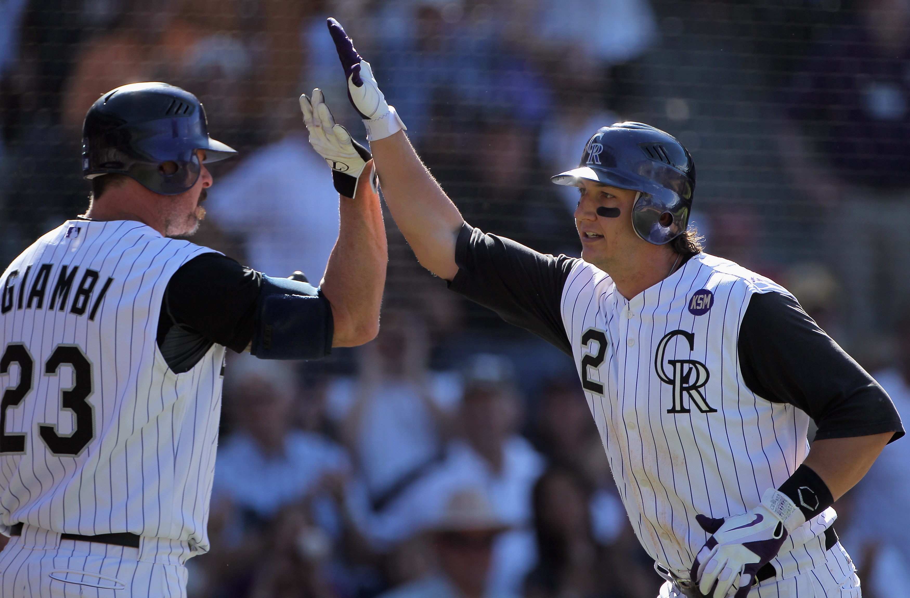 DENVER - SEPTEMBER 09:  Troy Tulowitzki #2 of the Colorado Rockies celebrates his eighth inning homerun off of pitcher Nick Masset of the Cincinnati Reds with Jason Giambi #23 at Coors Field on September 9, 2010 in Denver, Colorado. The Rockies defeated t