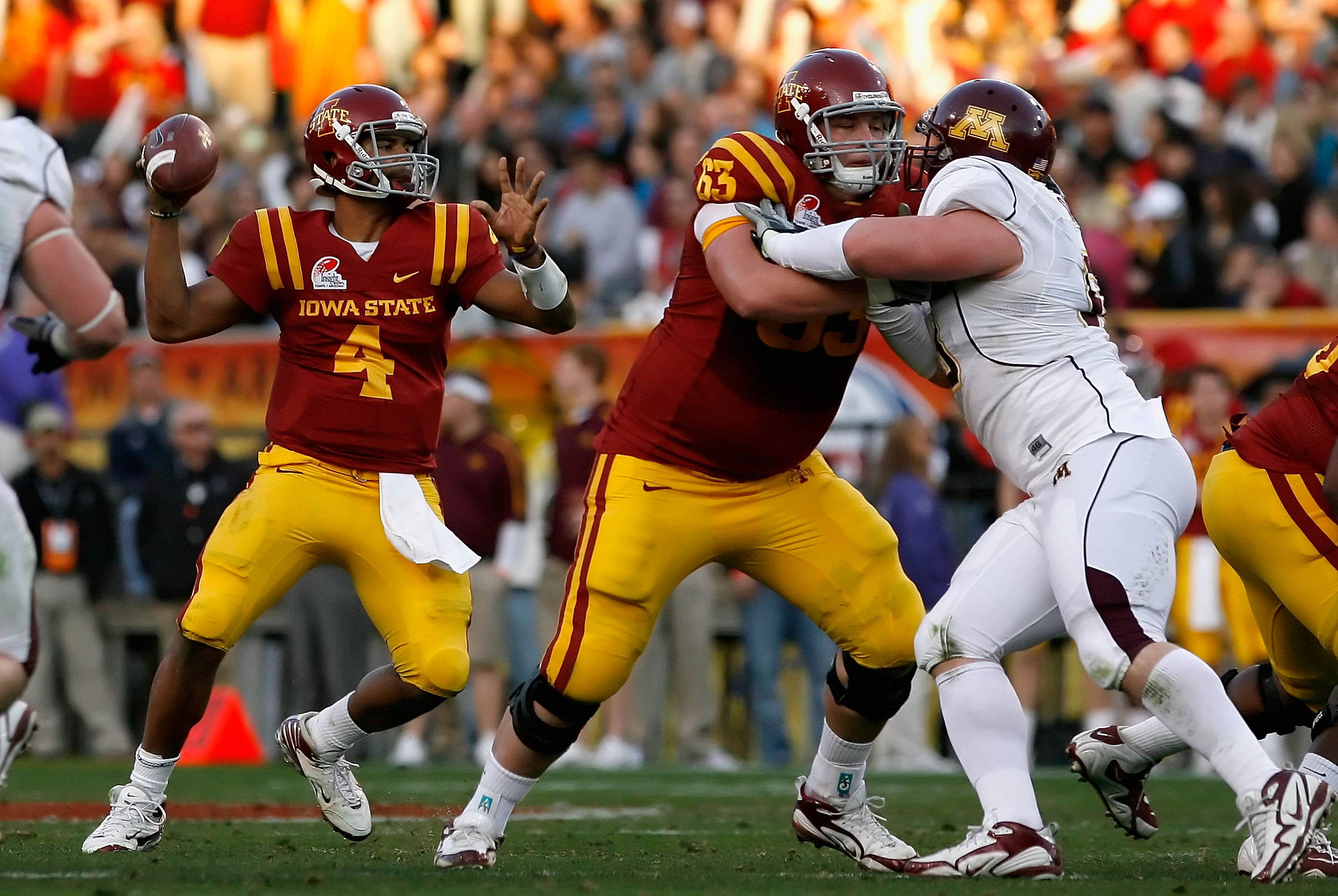 TEMPE, AZ - DECEMBER 31:  Quarterback Austen Arnaud #4 of the Iowa State Cyclones drops back to pass against the Minnesota Golden Gophers during the Insight Bowl at Arizona Stadium on December 31, 2009 in Tempe, Arizona. The Cyclones defeated the Golden G