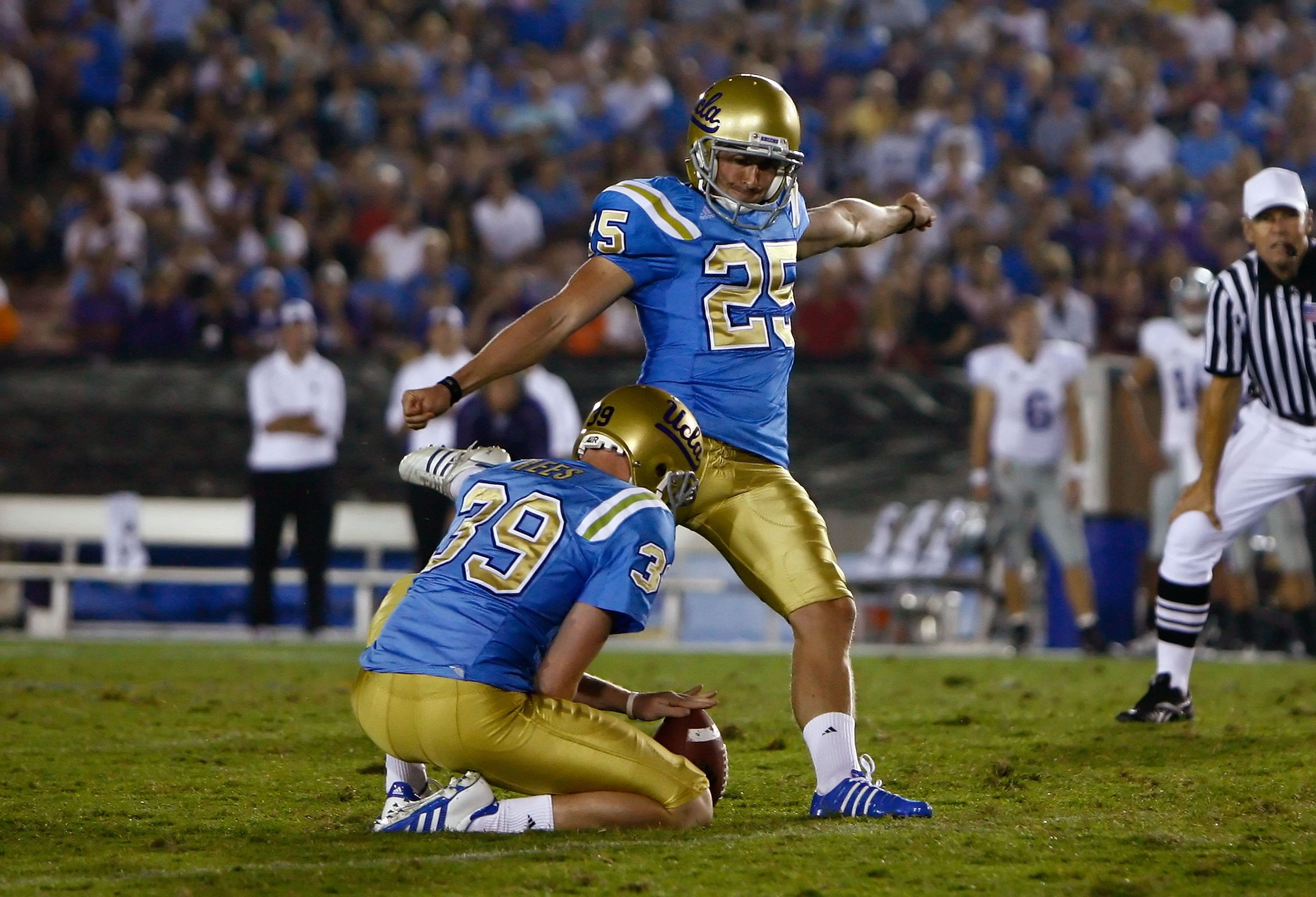 PASADENA, CA - SEPTEMBER 19:  Kai Forbath #25 of the UCLA Bruins kicks as Danny Rees #39 holds against the Kansas State Wildcats at the Rose Bowl on September 19, 2009 in Pasadena, California. UCLA defeated Kansas State 23-9.  (Photo by Jeff Gross/Getty I