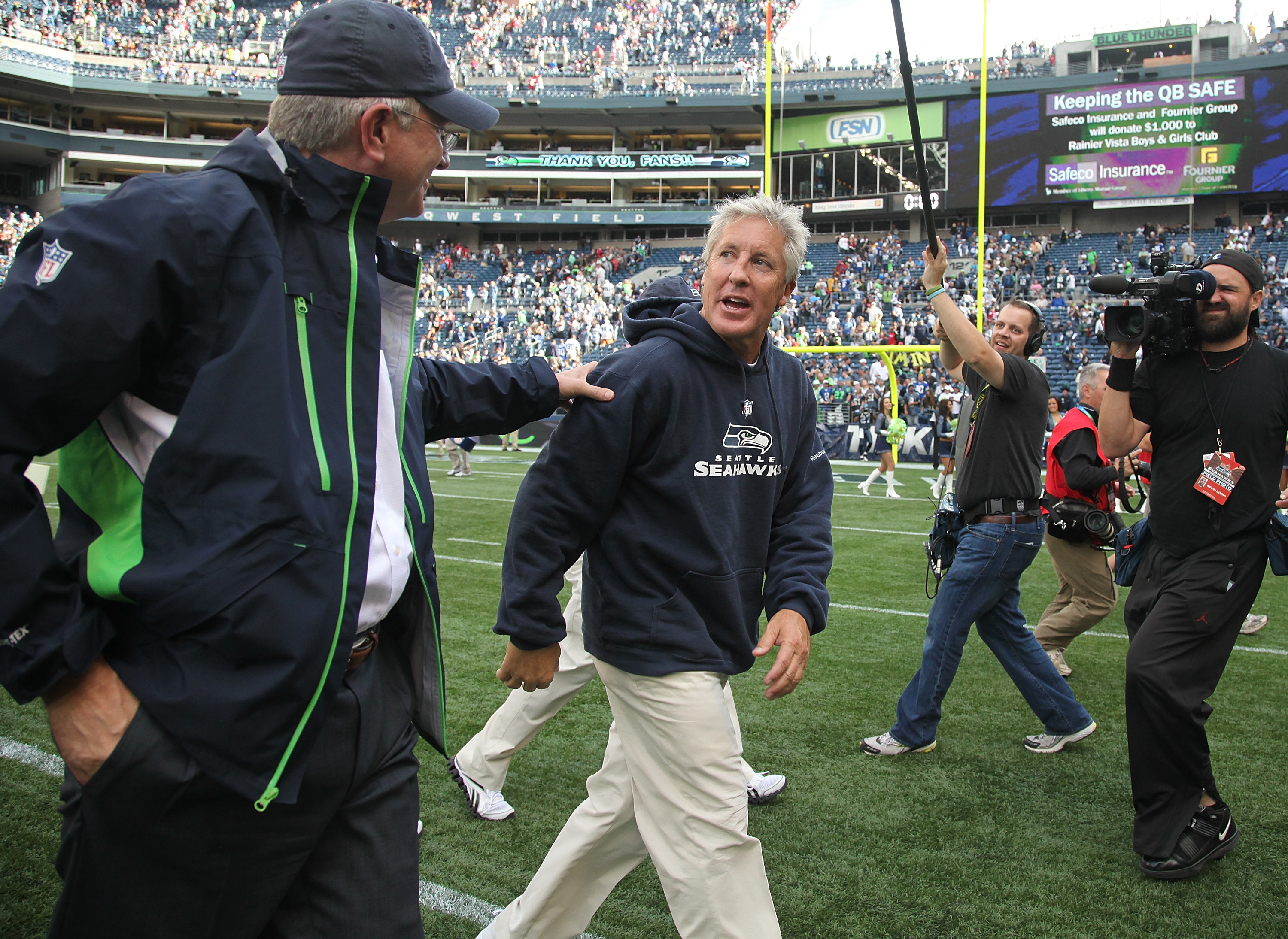 SEATTLE - SEPTEMBER 12:  Head coach Pete Carroll of the Seattle Seahawks (R) is congratulated by Seahawks' Chief Executive Officer  Tod Leiweke after the NFL season opener against the San Francisco 49ers at Qwest Field on September 12, 2010 in Seattle, Wa