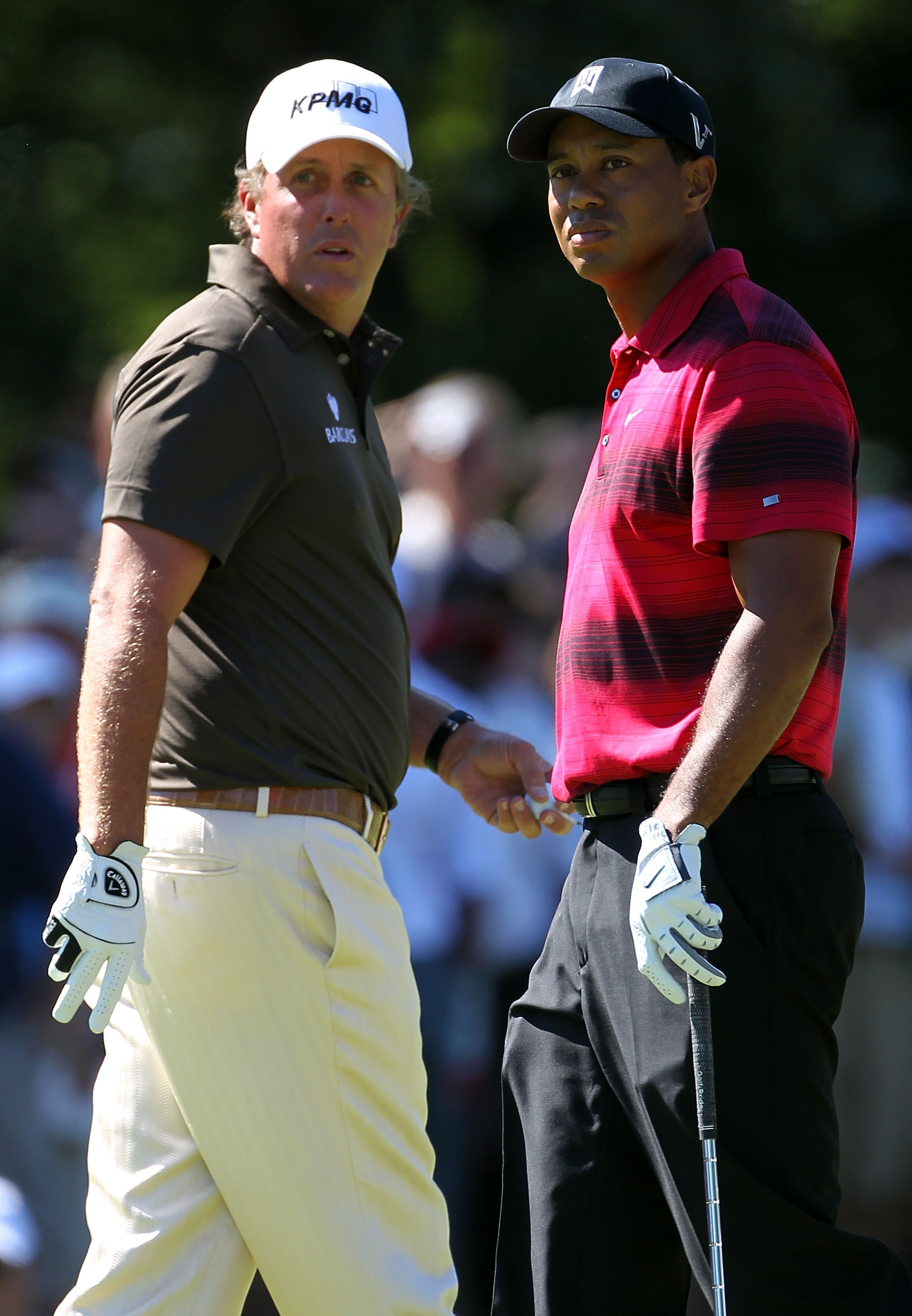 LEMONT, IL - SEPTEMBER 12:  Phil Mickelson and Tiger Woods pass each other by on the second hole during the final round of the BMW Championship at Cog Hill Golf & Country Club on September 12, 2010 in Lemont, Illinois.  (Photo by Jamie Squire/Getty Images