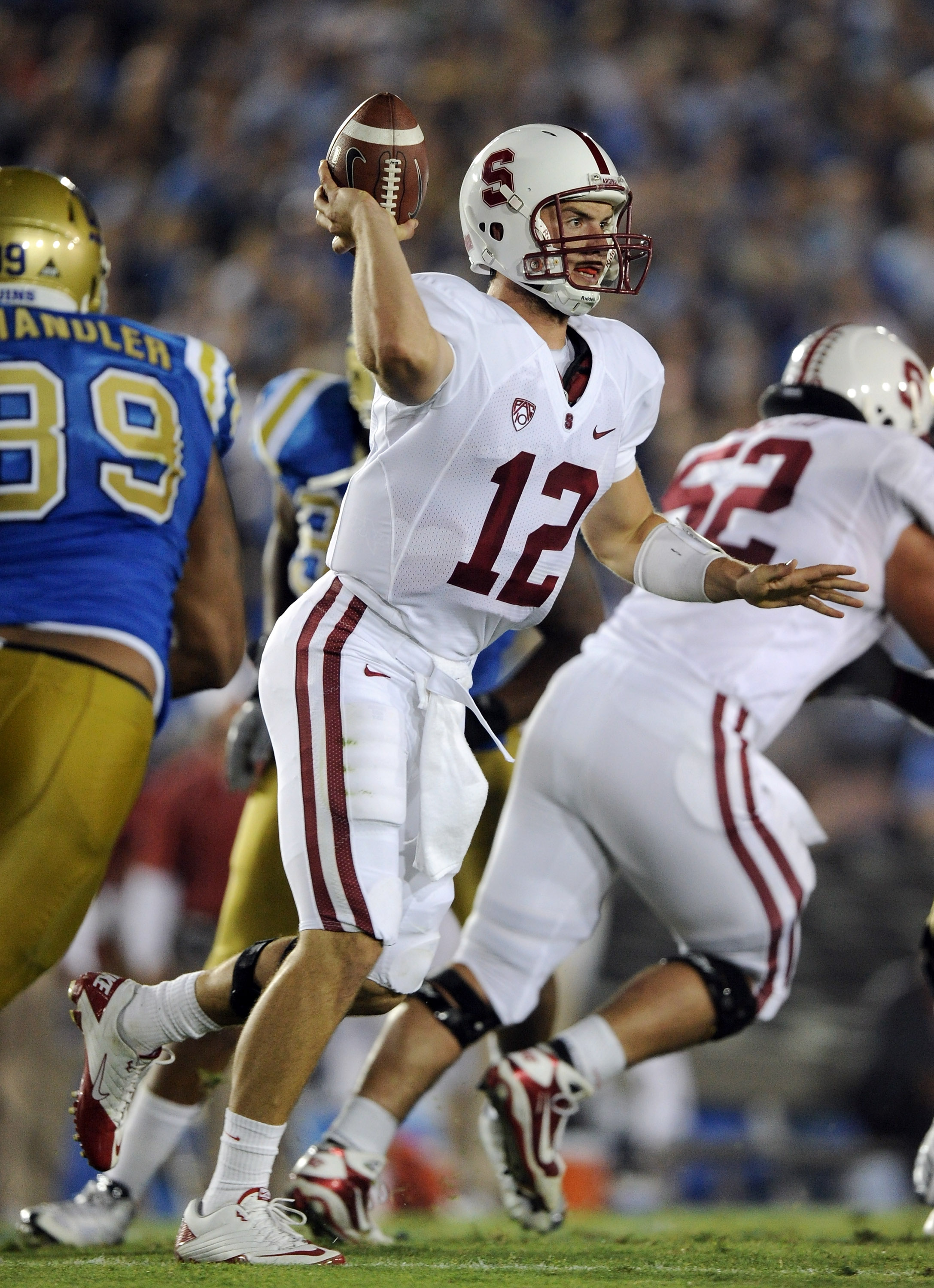 PASADENA, CA - SEPTEMBER 11:  Andrew Luck #12 of Stanford passes in the pocket against UCLA during the first quarter at Rose Bowl on September 11, 2010 in Pasadena, California.  (Photo by Harry How/Getty Images)