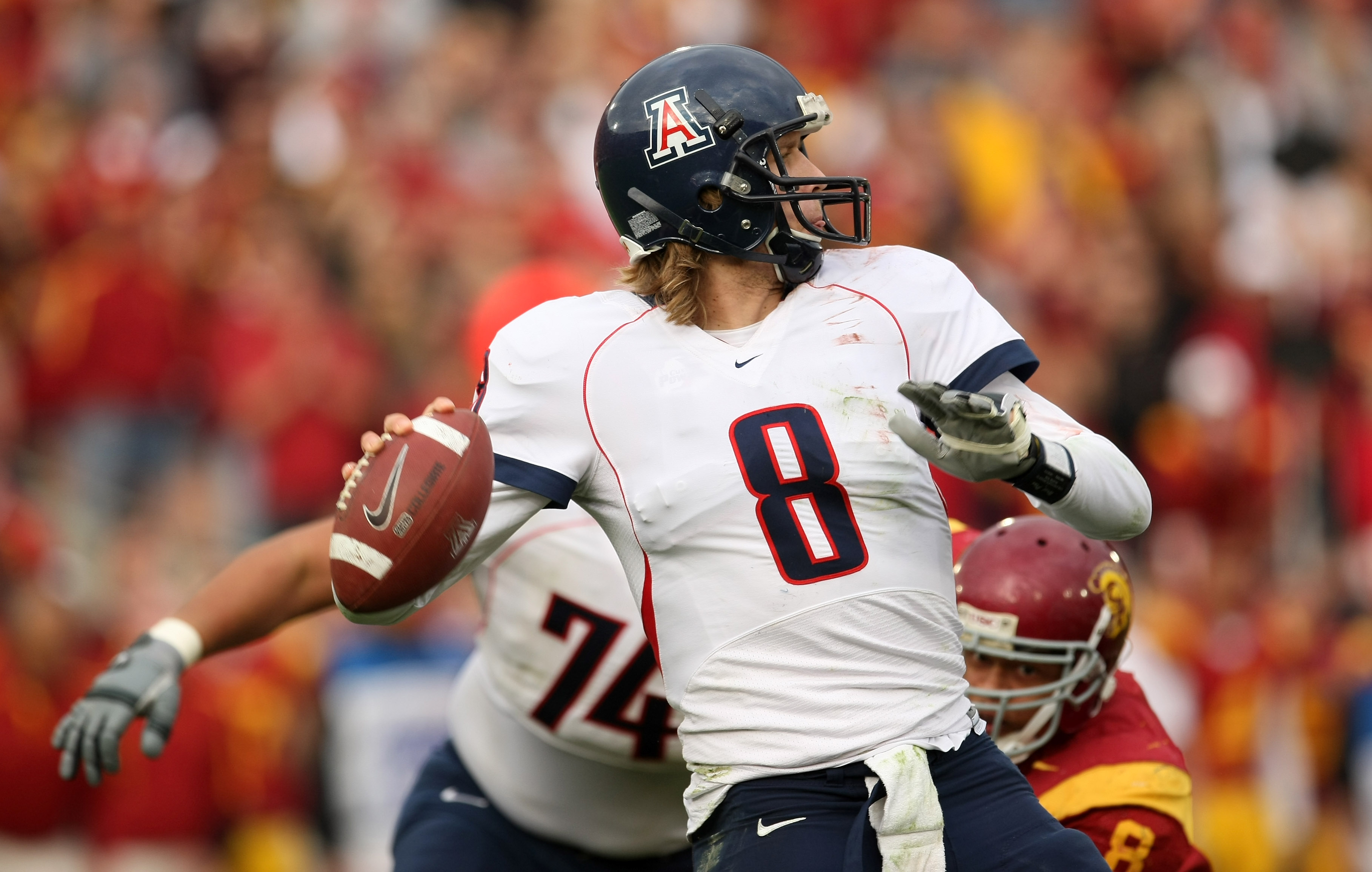 LOS ANGELES, CA - DECEMBER 05:  Quarterback Nick Foles #8 of the Arizona Wildcats throws a pass against the USC Trojans on December 5, 2009 at the Los Angeles Coliseum in Los Angeles, California. Arizona won 21-17.  (Photo by Stephen Dunn/Getty Images)