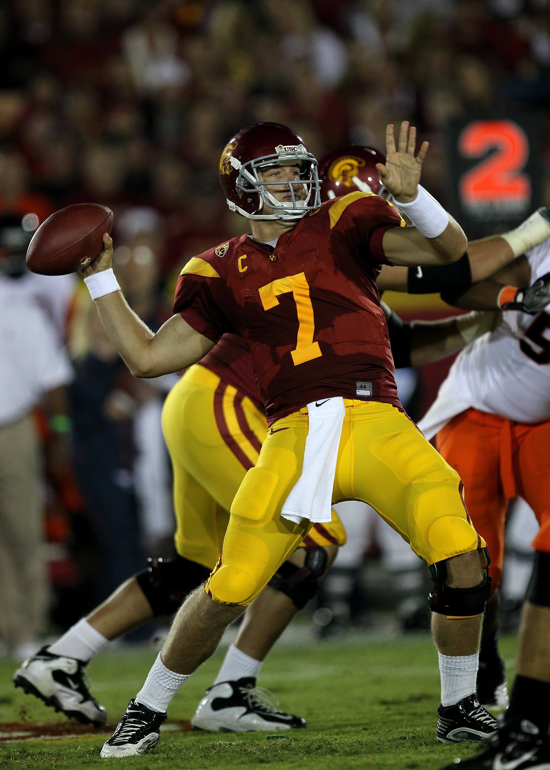LOS ANGELES, CA - SEPTEMBER 11:  Quarterback Matt Barkley #7 of the USC Trojans throws a pass against the Virginia Cavaliers at Los Angeles Memorial Coliseum on September 11, 2010 in Los Angeles, California. USC won 17-14.   (Photo by Stephen Dunn/Getty I