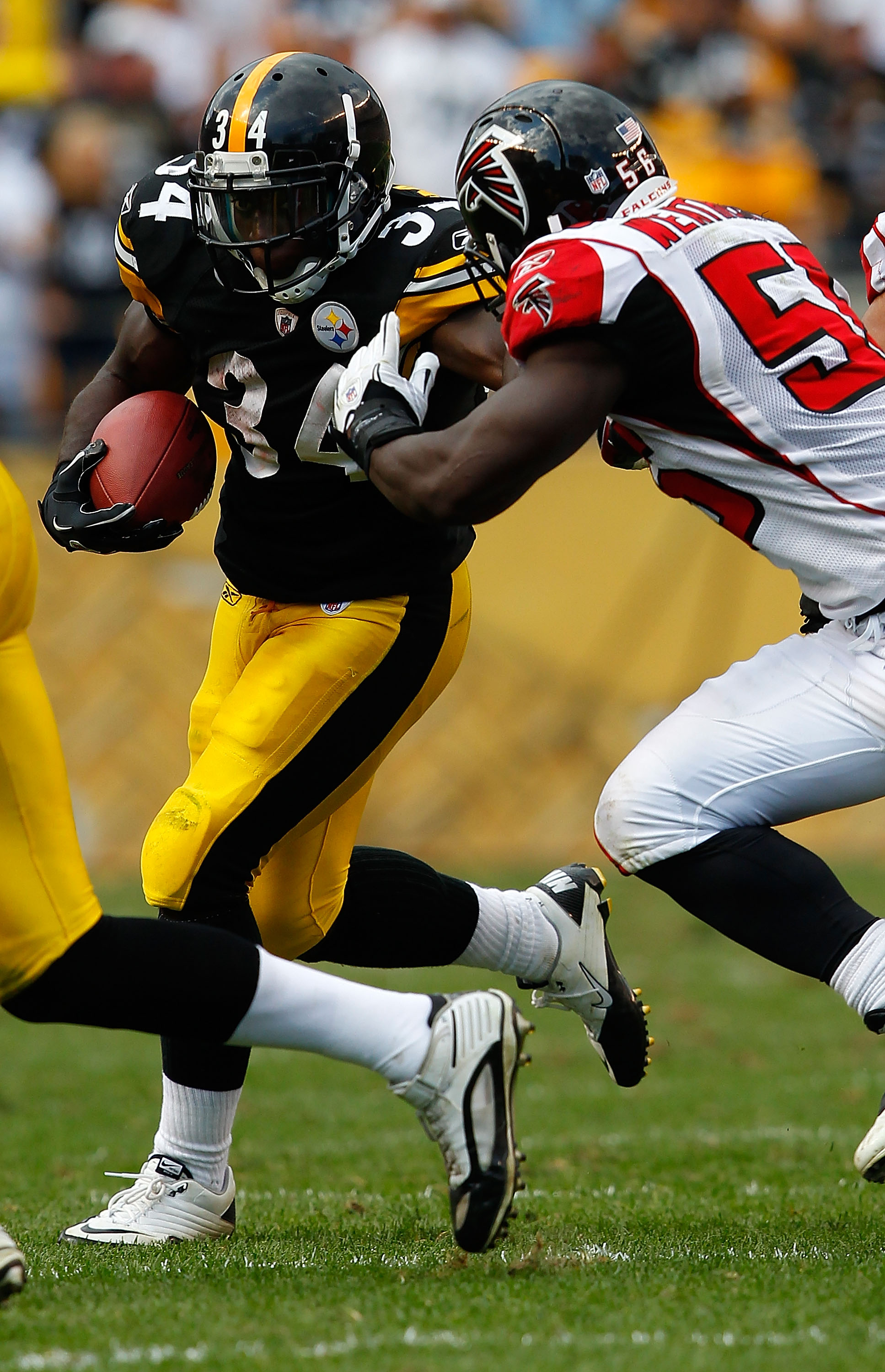 PITTSBURGH - SEPTEMBER 12:  Rashard Mendenhall #34 of the Pittsburgh Steelers attempts to run through Sean Weatherspoon #56 of the Atlanta Falcons during the NFL season opener game on September 12, 2010 at Heinz Field in Pittsburgh, Pennsylvania.  (Photo