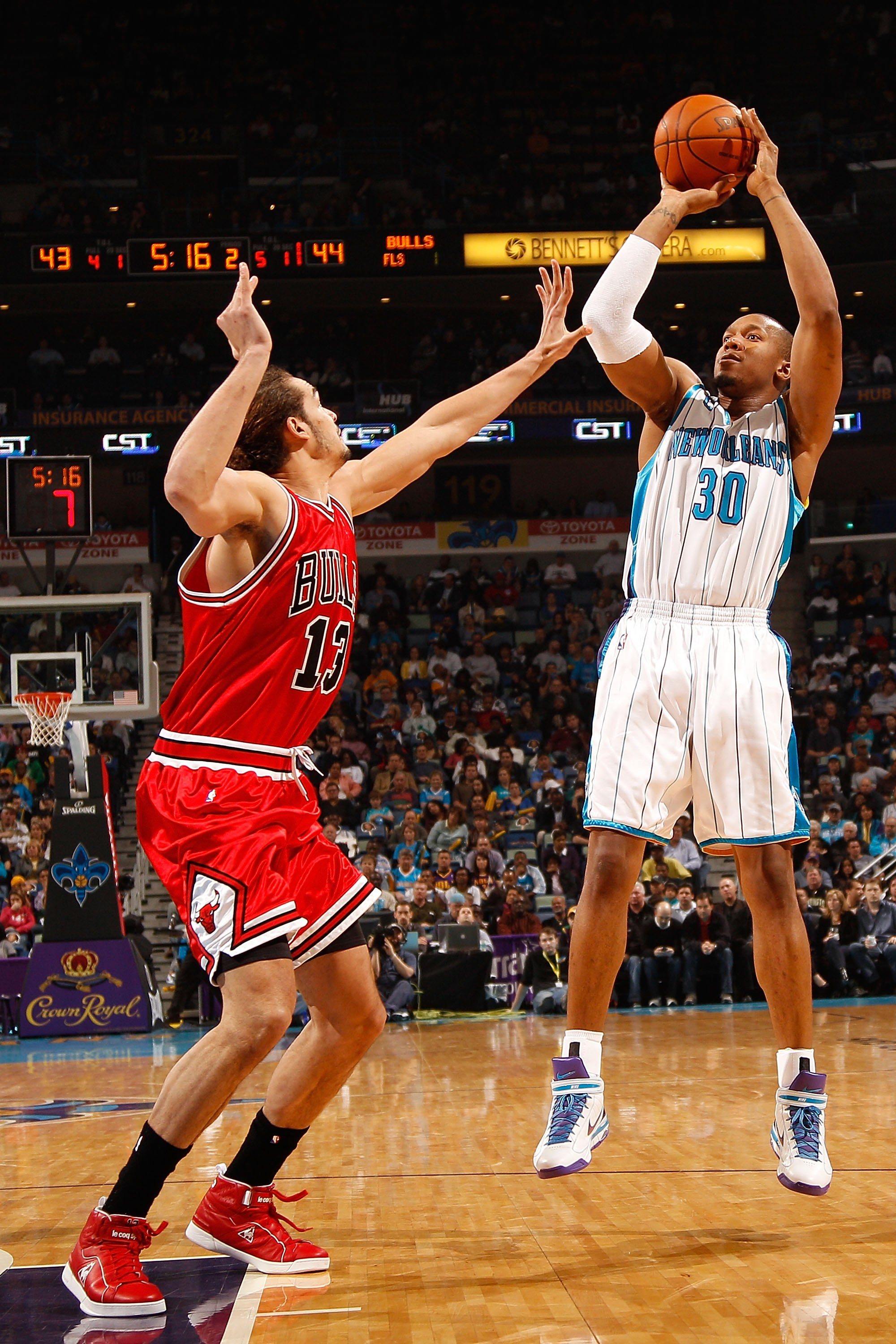NEW ORLEANS - JANUARY 29:  David West #3 of the New Orleans Hornets shoots the ball over Joakim Noah #13 of the Chicago Bulls at the New Orleans Arena on January 29, 2010 in New Orleans, Louisiana.   NOTE TO USER: User expressly acknowledges and agrees th