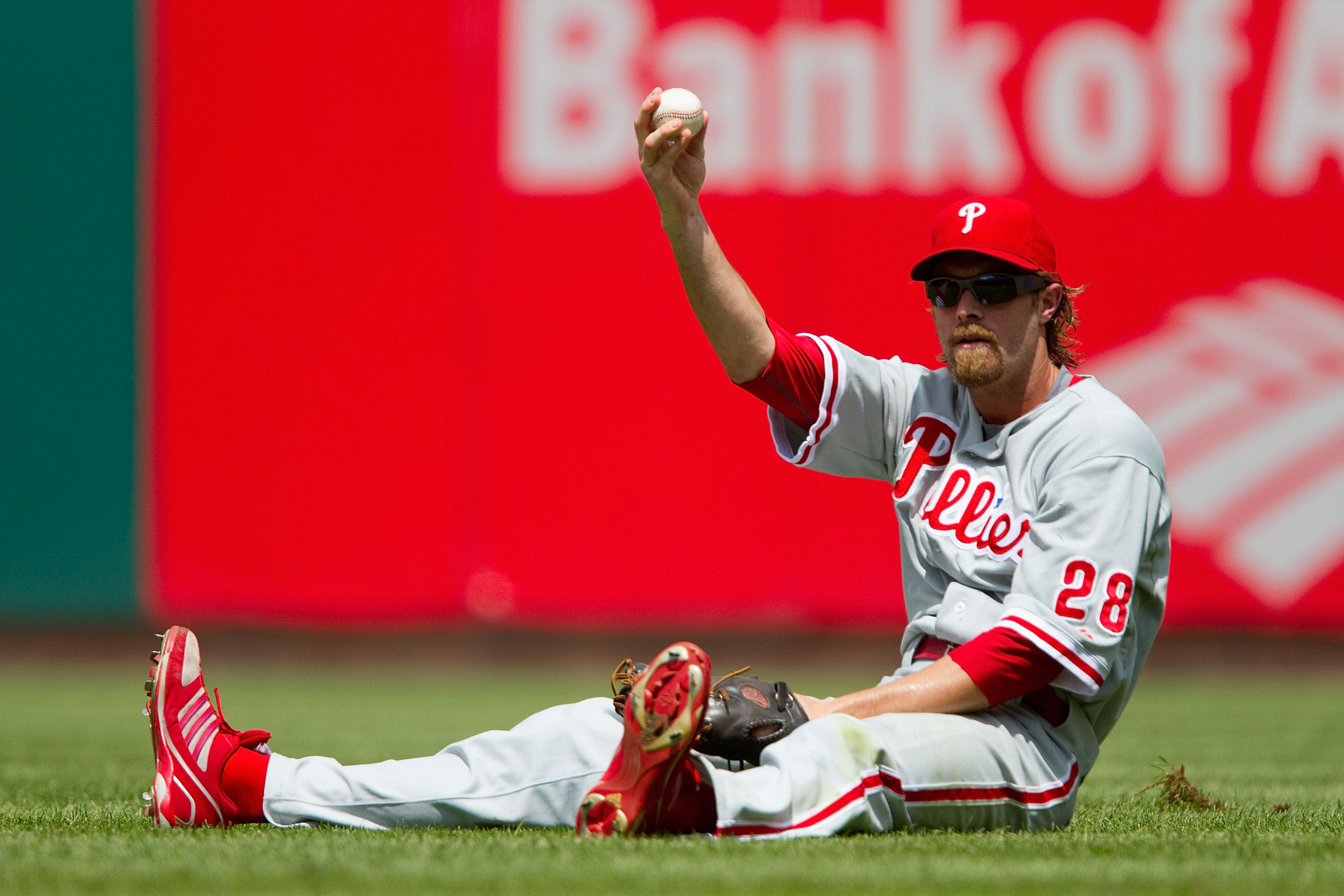 ST. LOUIS - JULY 22: Jayson Werth #28 of the Philadelphia Phillies shows the ball after making a sliding catch against the St. Louis Cardinals at Busch Stadium on July 22, 2010 in St. Louis, Missouri. The Phillies defeated the Cardinals 2-0.  (Photo by Di