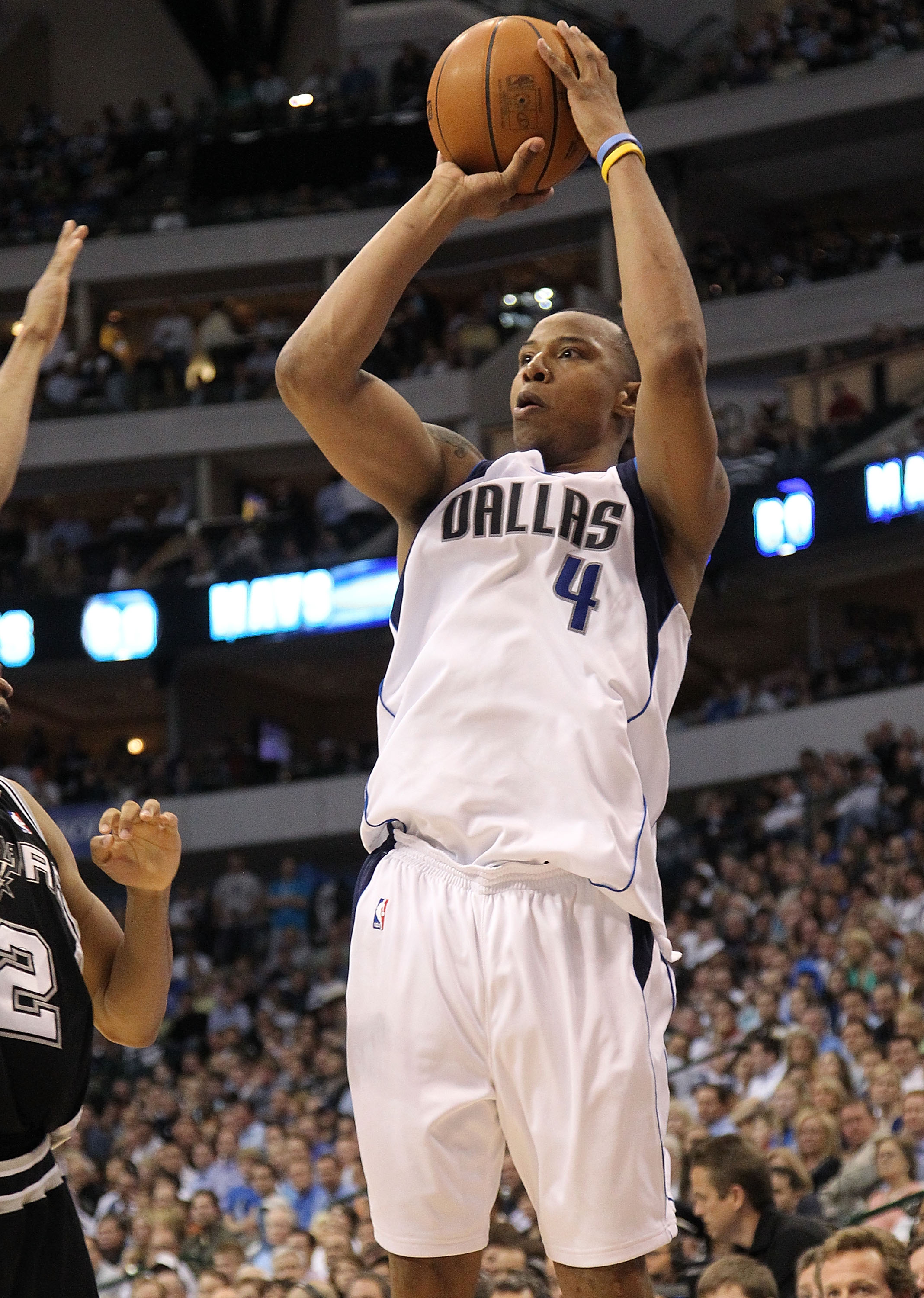 DALLAS - APRIL 27:  Forward Caron Butler #4 of the Dallas Mavericks takes a shot against the San Antonio Spurs in Game Five of the Western Conference Quarterfinals during the 2010 NBA Playoffs at American Airlines Center on April 27, 2010 in Dallas, Texas