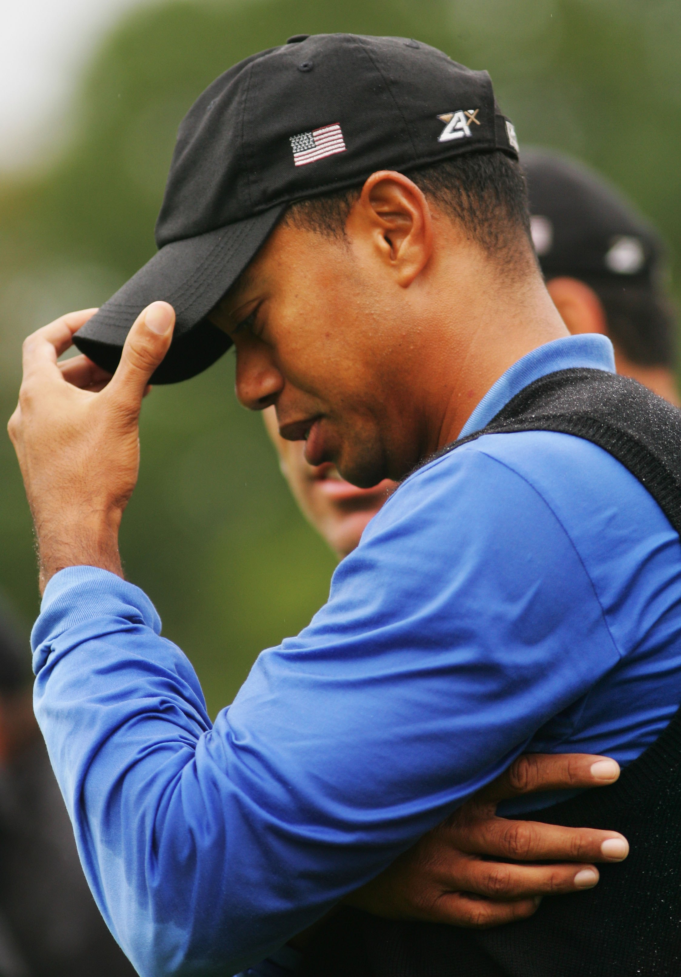 KILDARE, IRELAND - SEPTEMBER 23:  Tiger Woods of USA shows his dejection following defeat during the morning fourballs on the second day of the 2006 Ryder Cup at The K Club on September 23, 2006 in Straffan, Co. Kildare, Ireland.  (Photo by Ross Kinnaird/