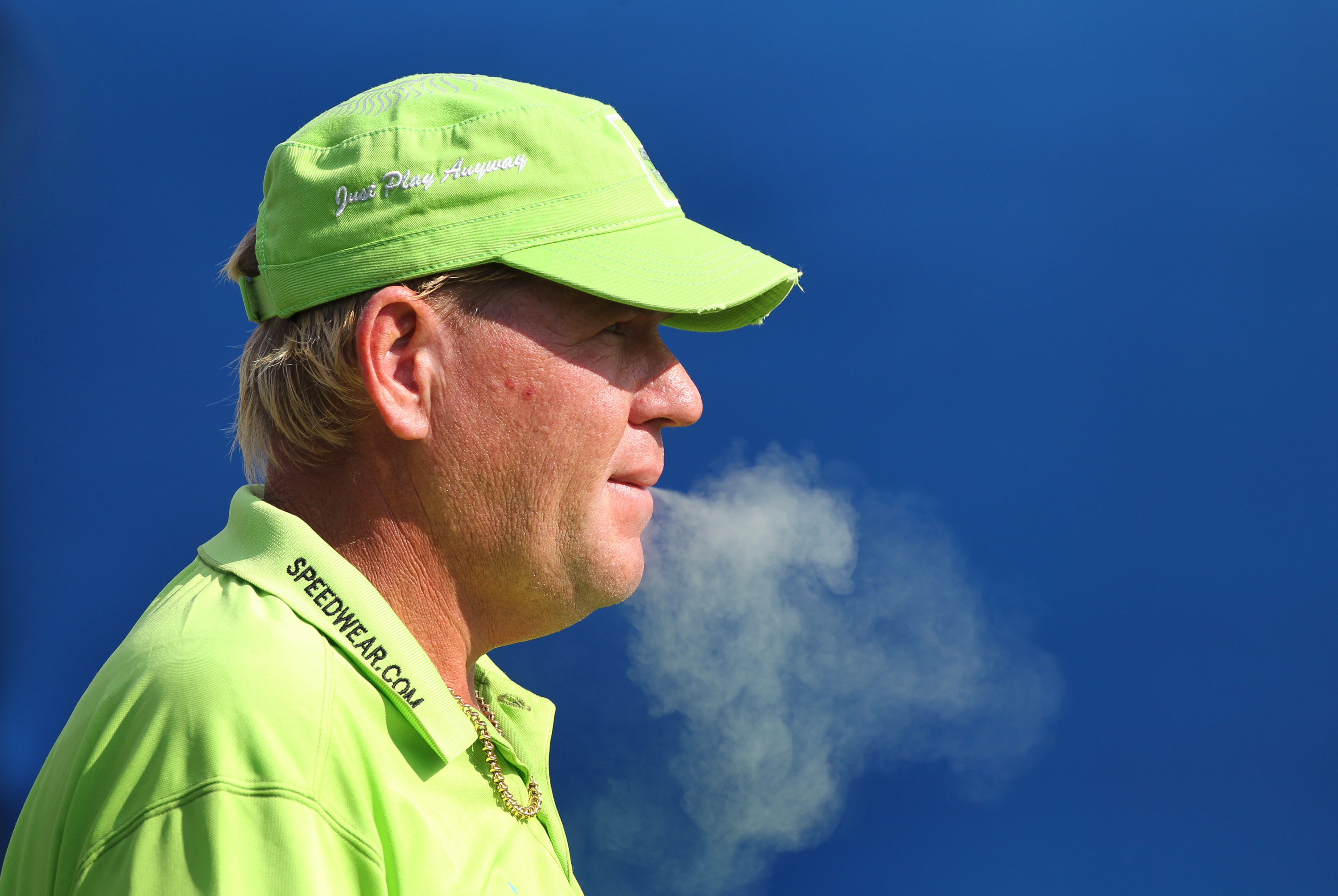 GREENSBORO, NC - AUGUST 20: John Daly has a smoke on the 10th tee during the second round of the Wyndham  Championship at Sedgefield Country Club on August 20, 2010 in Greensboro, North Carolina. (Photo by Hunter Martin/Getty Images)