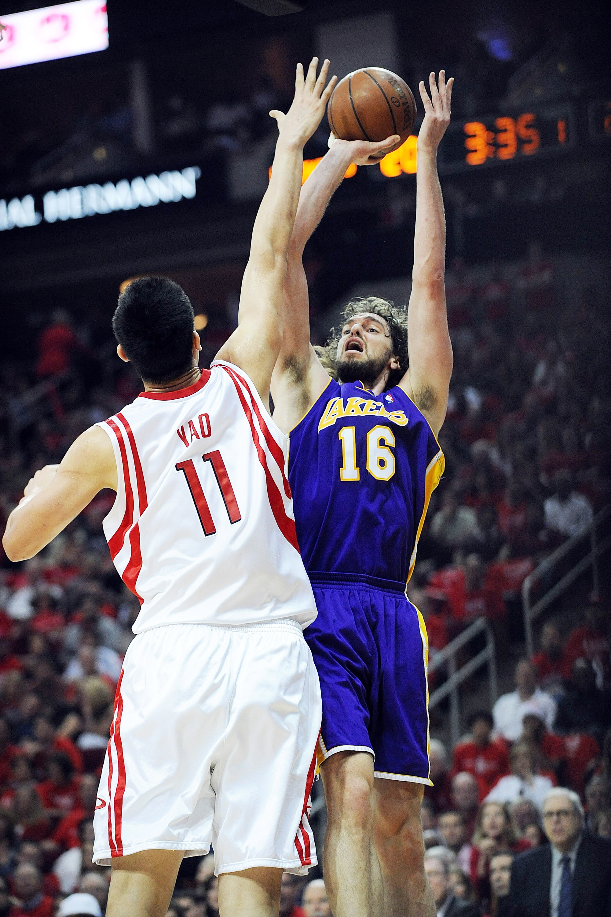 HOUSTON - MAY 08:  Forward Pau Gasol #16 of the Los Angeles Lakers takes a shot against Yao Ming #11 of the Houston Rockets in Game Three of the Western Conference Semifinals during the 2009 NBA Playoffs at Toyota Center on May 8, 2009 in Houston, Texas.