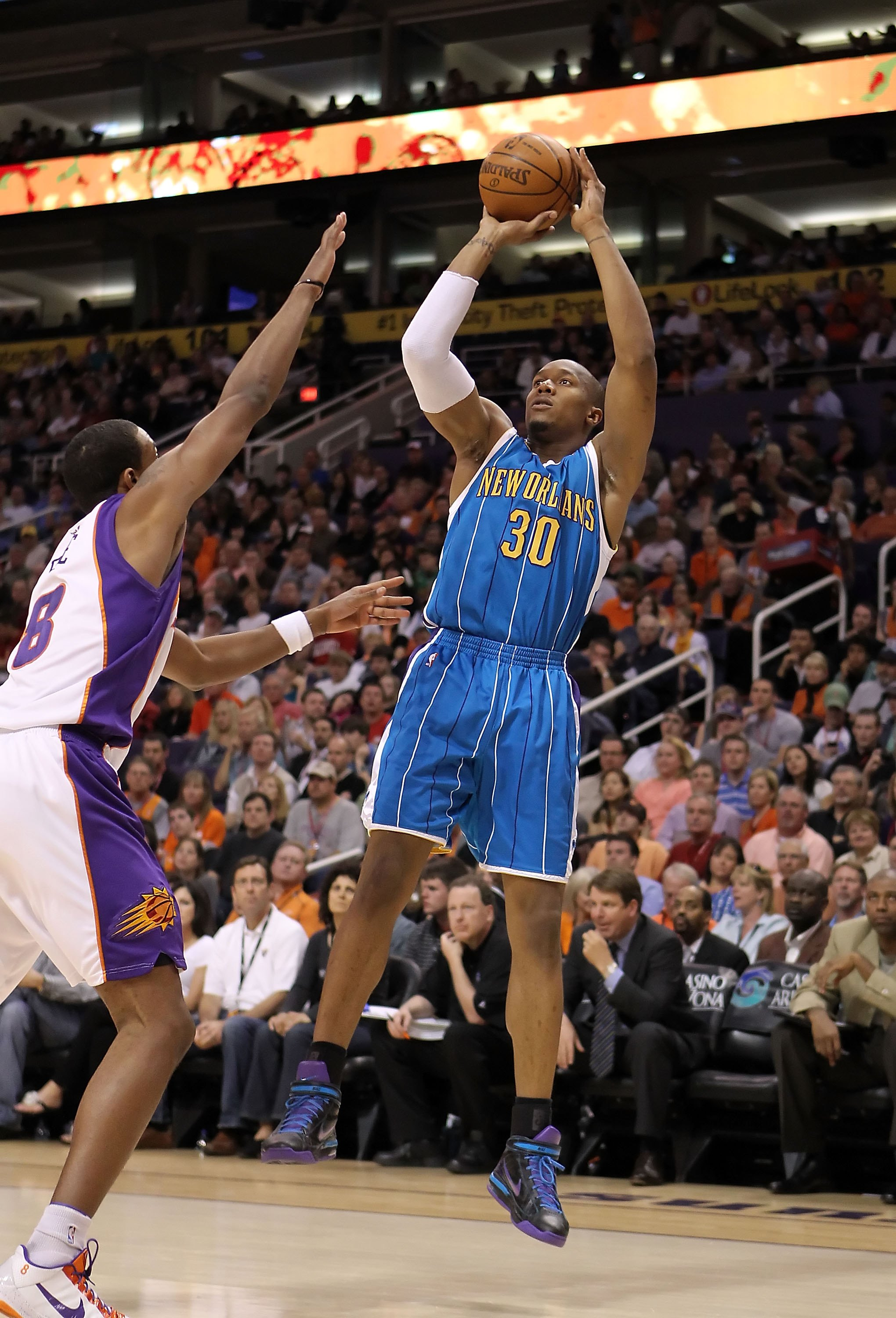 PHOENIX - MARCH 14:  David West #30 of the New Orleans Hornets puts up a shot during the NBA game against the Phoenix Suns at US Airways Center on March 14, 2010 in Phoenix, Arizona.  The Suns defeated the Hornets 120-106.  NOTE TO USER: User expressly ac