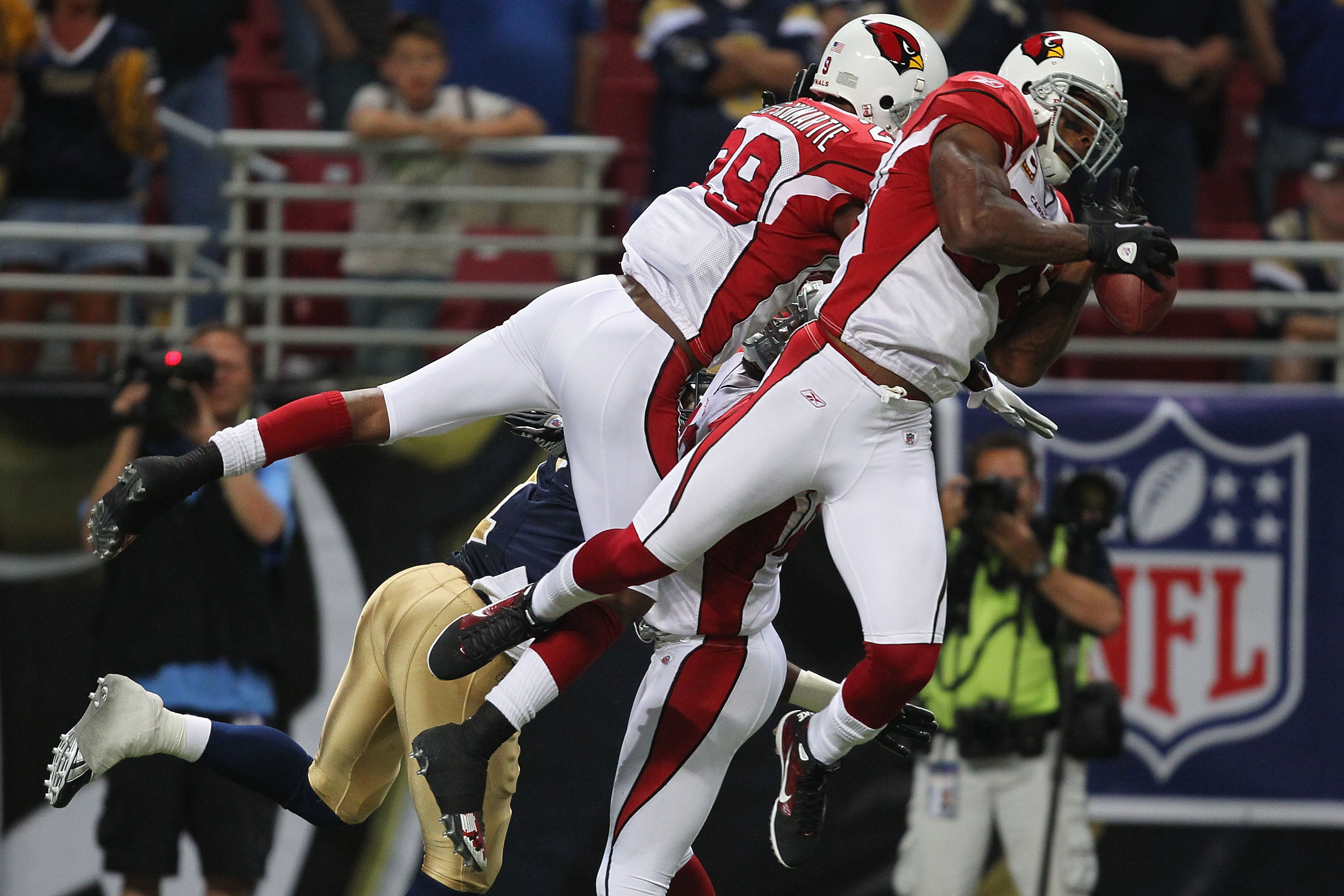 ST. LOUIS - SEPTEMBER 12: Adrian Wilson #24 of the Arizona Cardinals knocks down the final pass of the game against the St. Louis Rams during the NFL season opener at the Edward Jones Dome on September 12, 2010 in St. Louis, Missouri.  The Cardinals beat