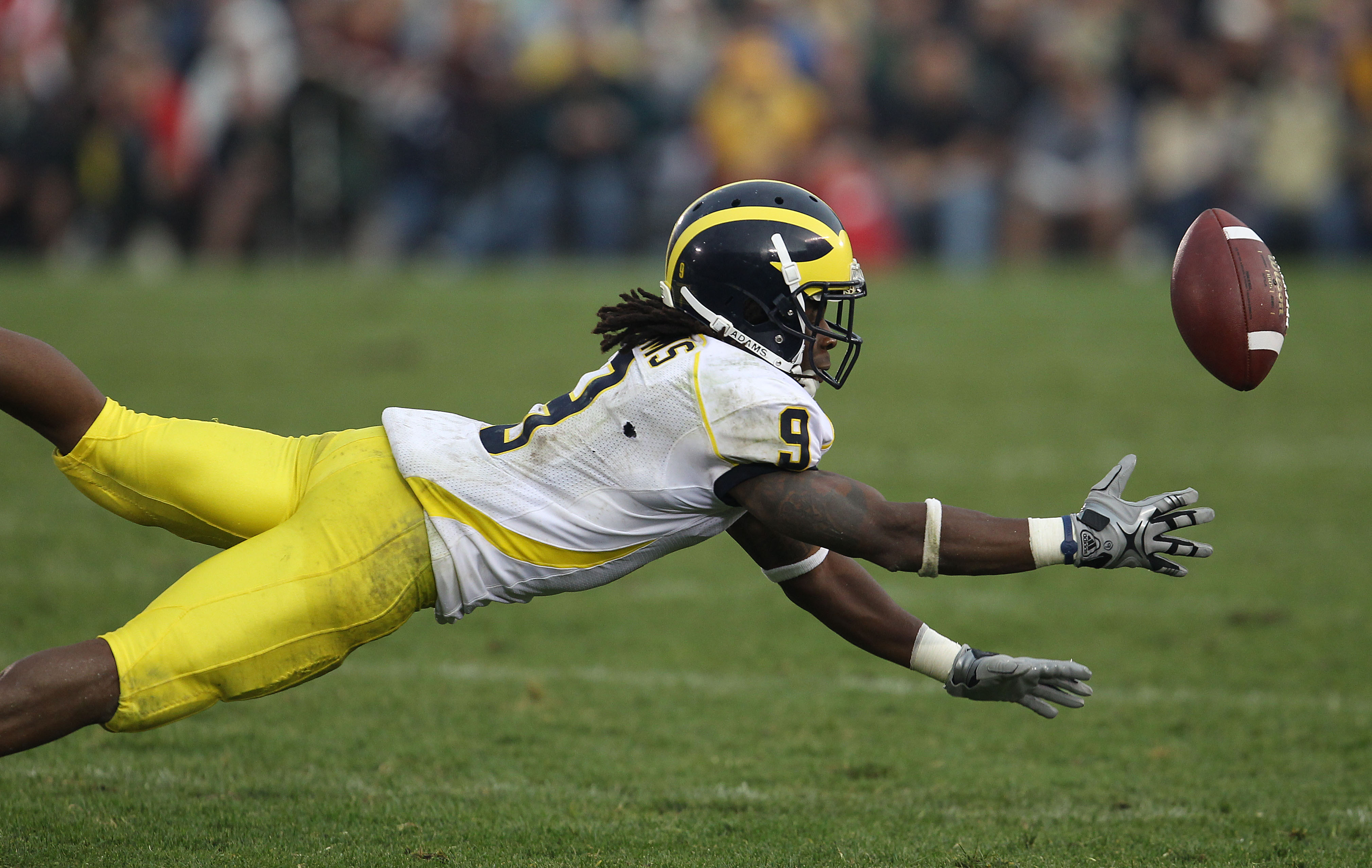 SOUTH BEND, IN - SEPTEMBER 11: Martavious Odoms #9 of the Michigan Wolverines misses a catch against the Notre Dame Fighting Irish at Notre Dame Stadium on September 11, 2010 in South Bend, Indiana. Michigan defeated Notre Dame 28-24. (Photo by Jonathan D