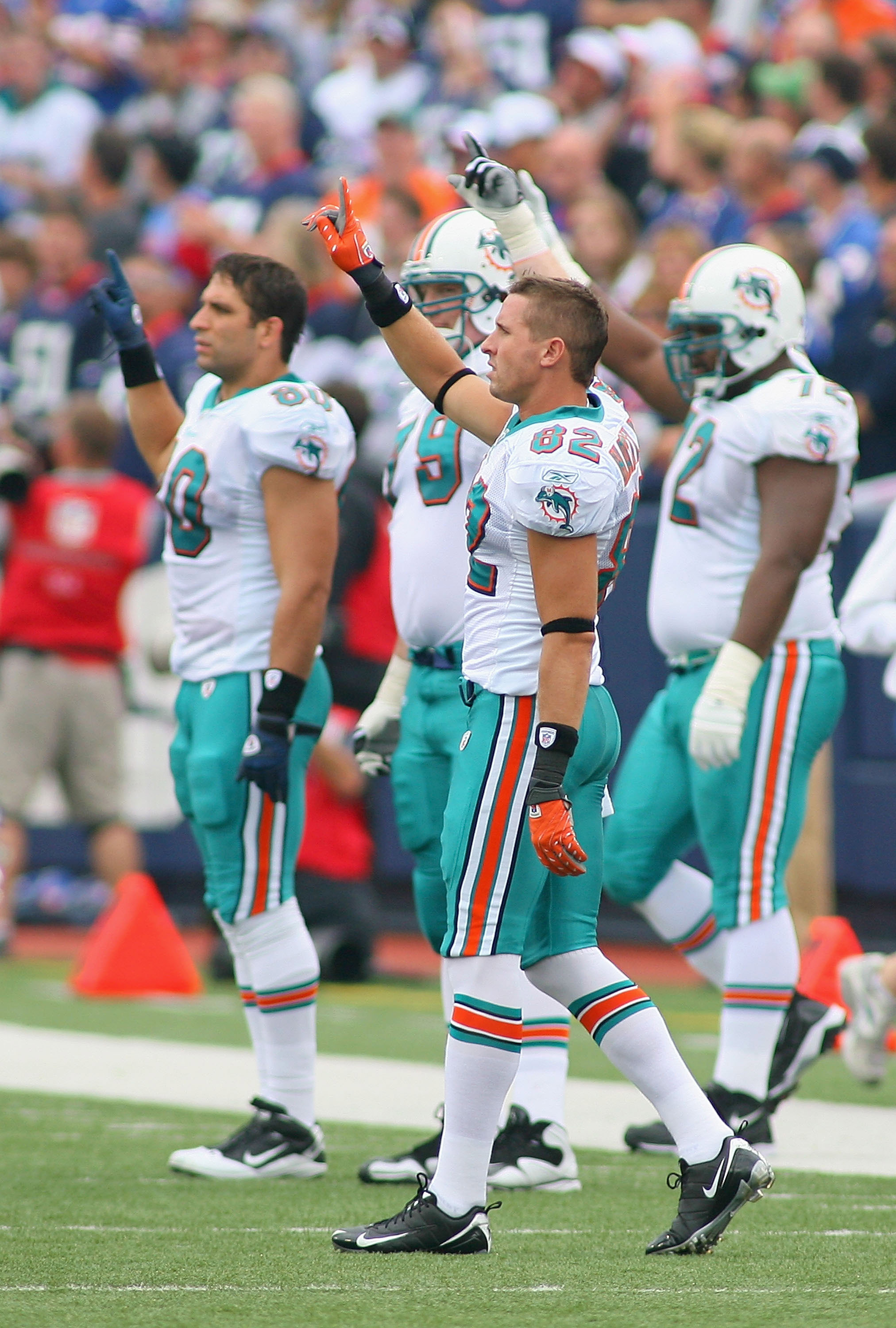 ORCHARD PARK, NY - SEPTEMBER 12: Brian Hartline #82 of the Miami Dolphins raises his finger with teammates to show solidarity amongst the NFL players for the upcoming labor talks prior to playing the Buffalo Bills in the NFL season opener at Ralph Wilson