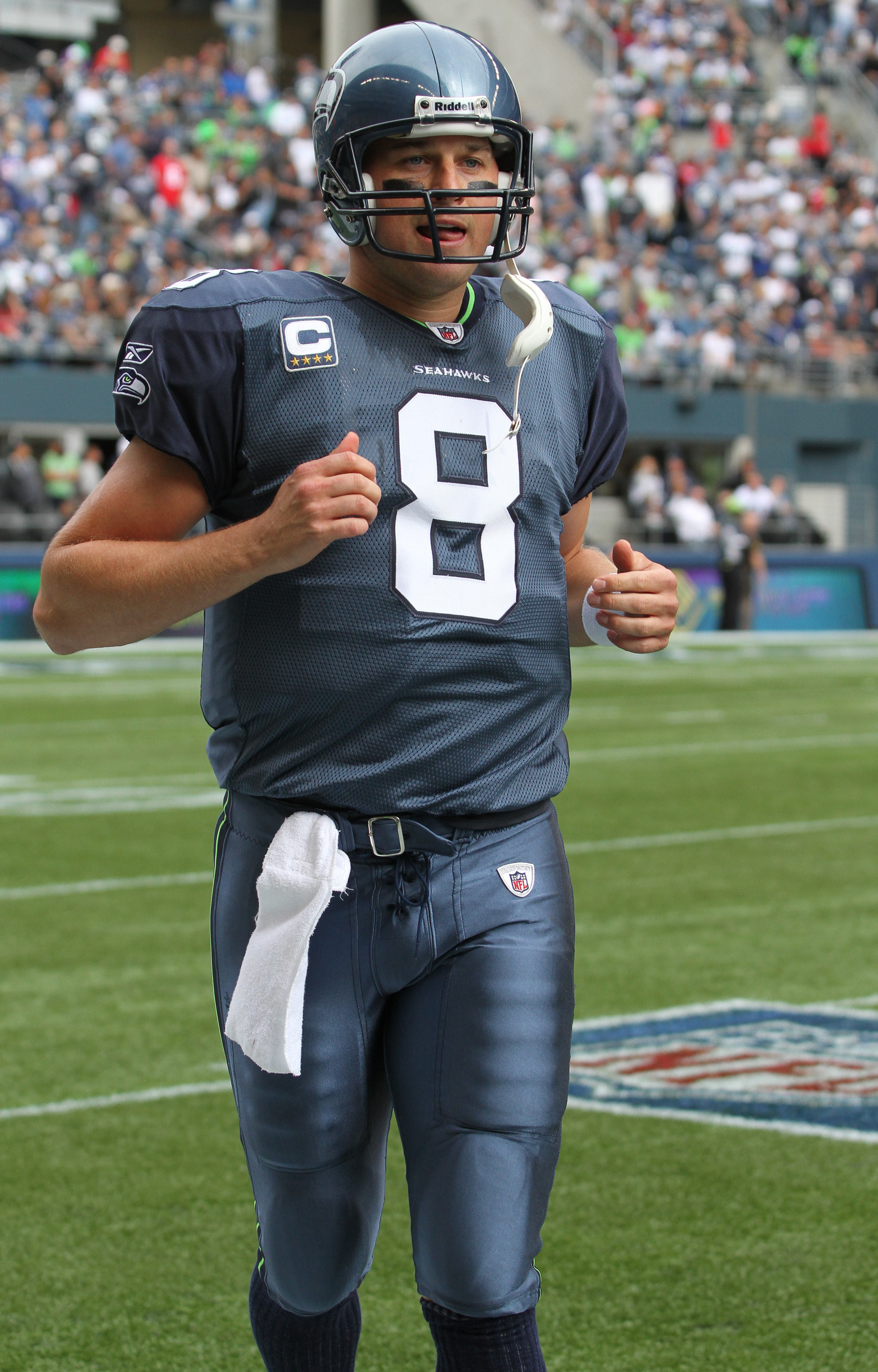 SEATTLE - SEPTEMBER 12:  Quarterback Matt Hasselbeck #8 of the Seattle Seahawks comes off the field after being intercepted on the first play from scrimmage during the NFL season opener against the San Francisco 49ers at Qwest Field on September 12, 2010