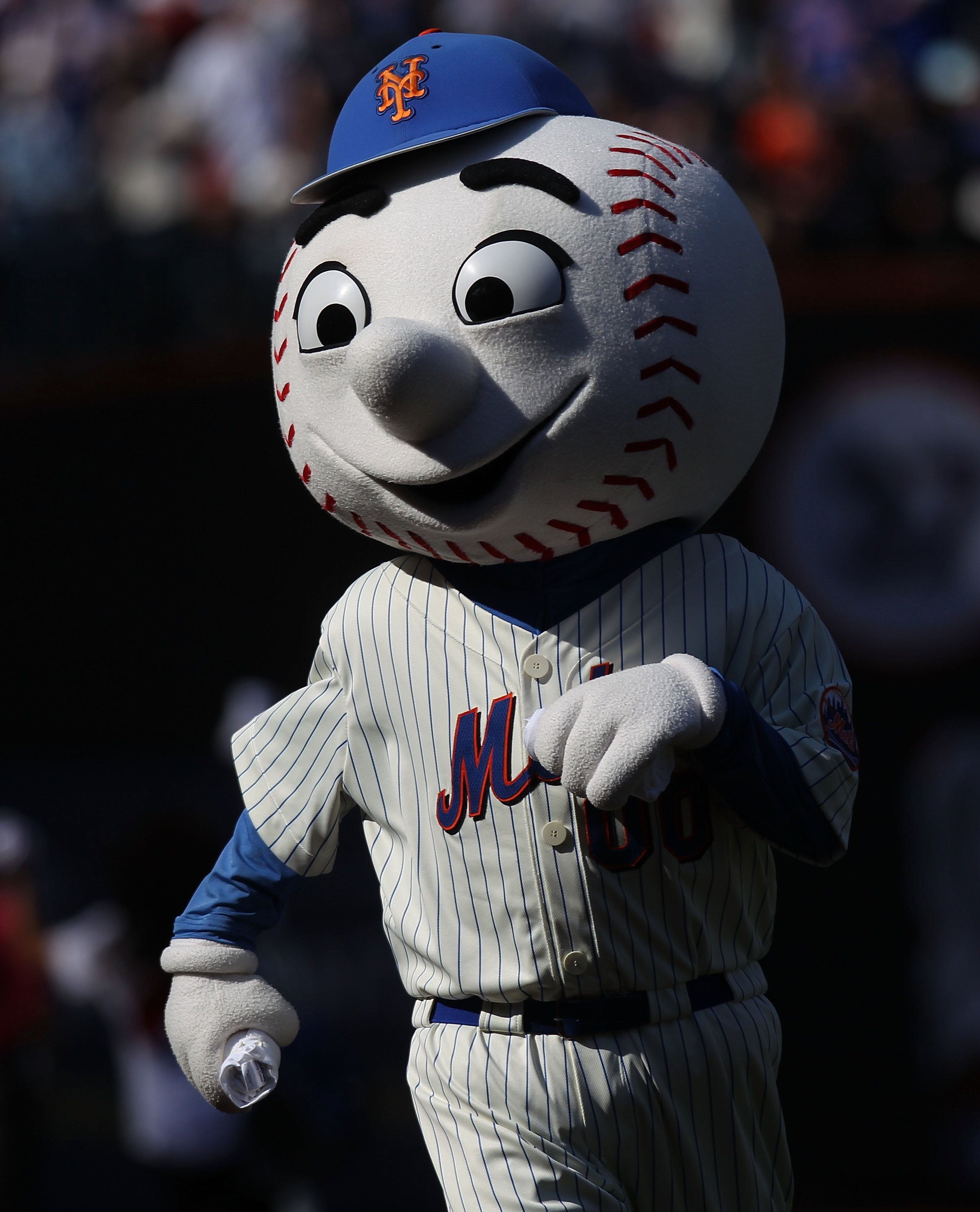 NEW YORK - APRIL 05:  Mr. Met dances during the game between the New York Mets and the Florida Marlins during their Opening Day Game at Citi Field on April 5, 2010 in the Flushing neighborhood of the Queens borough of New York City.  (Photo by Nick Laham/