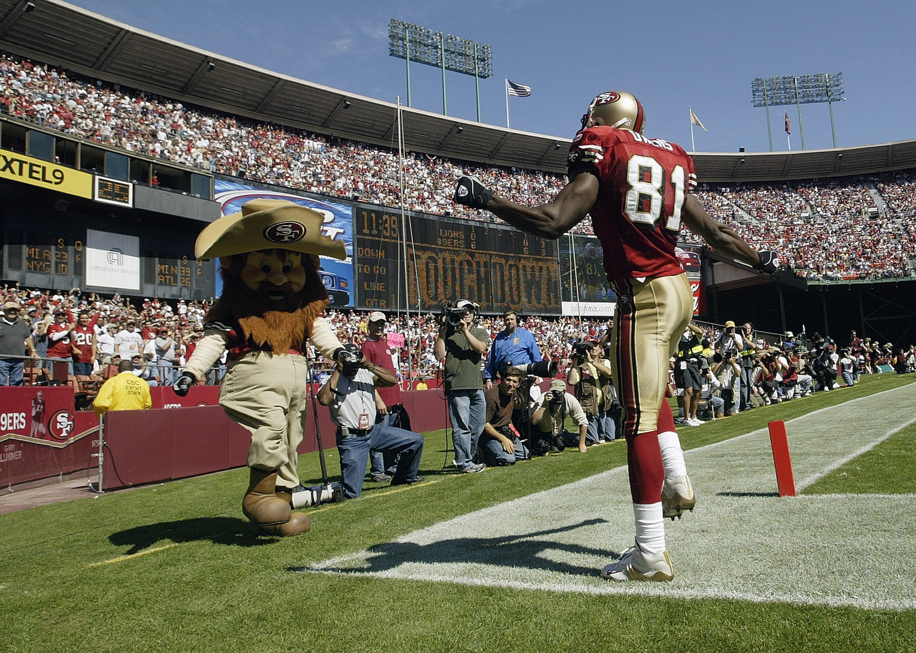 SAN FRANCISCO - OCTOBER 5:  Wide receiver Terrell Owens #81 of the San Francisco 49ers does a dance with 'Sourdough Sam' to celebrate his touchdown catch against the Detroit Lions on October 5, 2003 at 3 Com Park in San Francisco, California.  The 49ers d