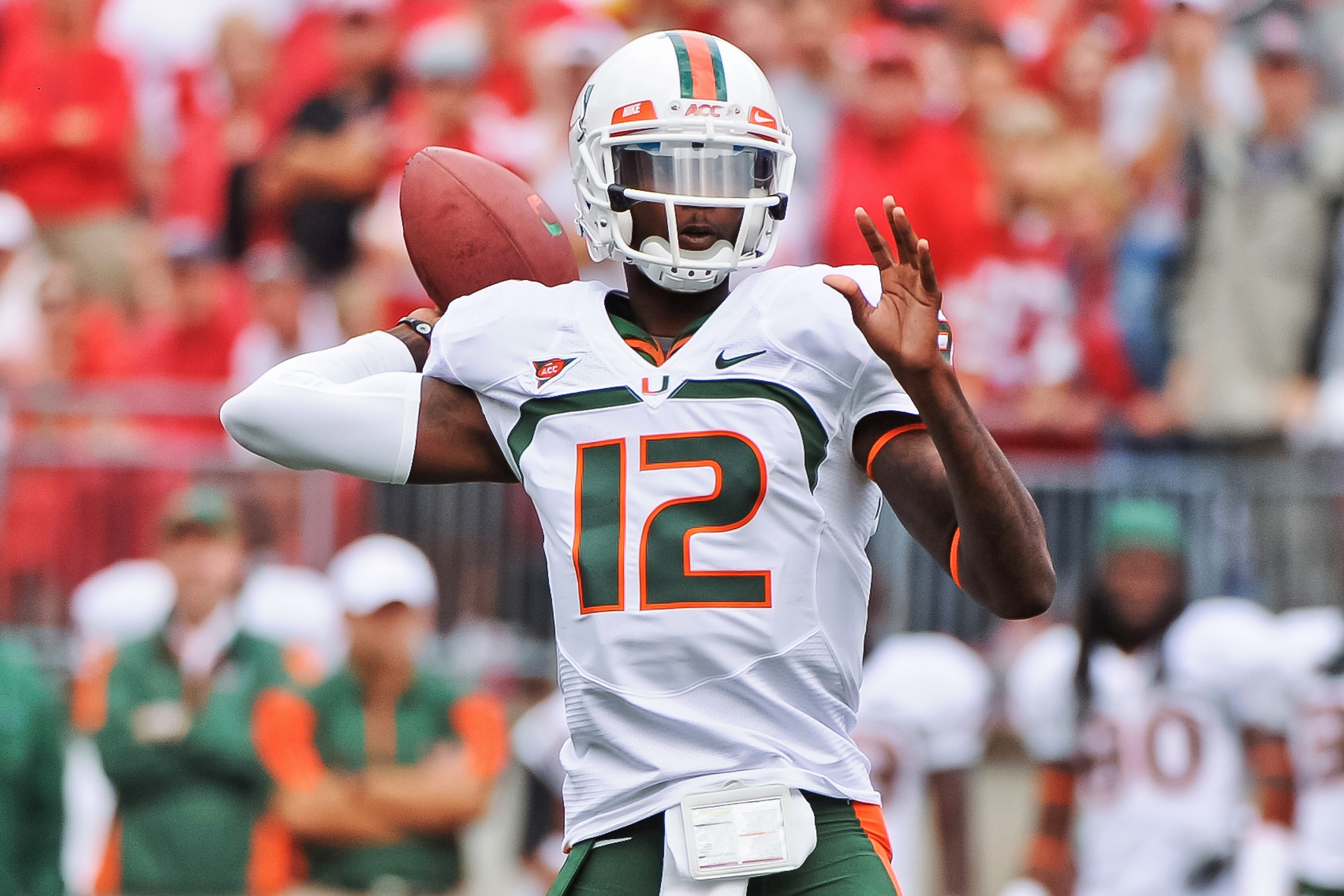 COLUMBUS, OH - SEPTEMBER 11:  Quarterback Jacory Harris #12 of the Miami Hurricanes passes the ball against the Ohio State Buckeyes at Ohio Stadium on September 11, 2010 in Columbus, Ohio.  (Photo by Jamie Sabau/Getty Images)