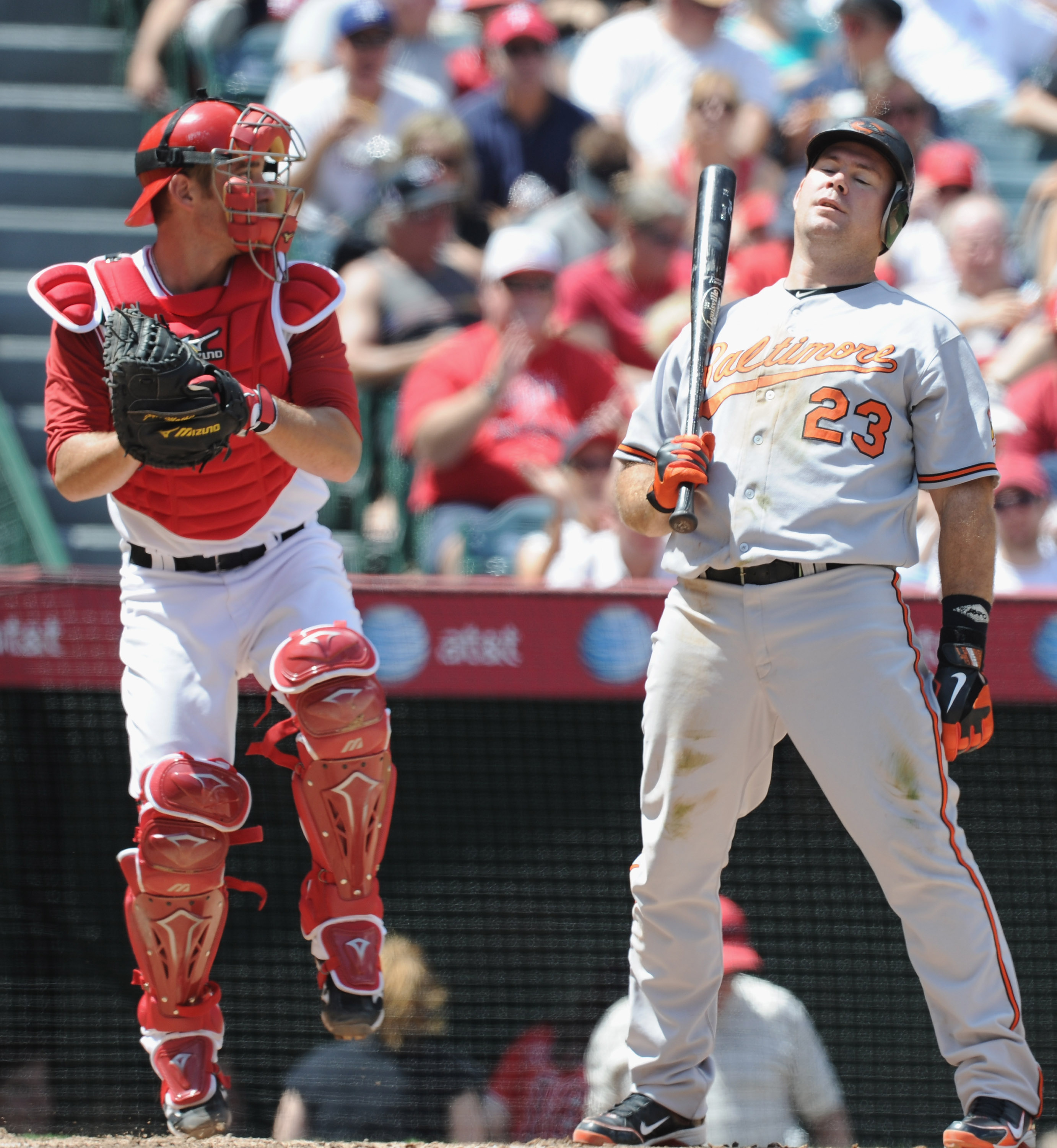 ANAHEIM, CA - AUGUST 29:  Ty Wigginton #23 of the Baltimore Orioles reacts to his strikeout in front of Jeff Mathis #5 of the Los Angeles Angels of Anaheim at Angel Stadium on August 29, 2010 in Anaheim, California.  (Photo by Harry How/Getty Images)