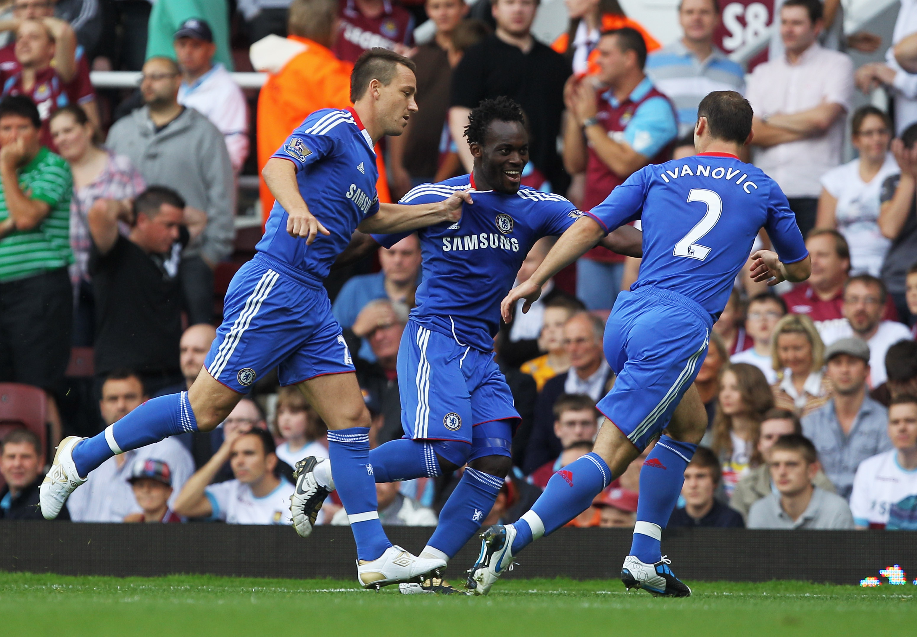 LONDON, ENGLAND - SEPTEMBER 11:  Michael Essien of Chelsea (C) celebrates with John Terry (L) and Branislav Ivanovic as he scores their first goal during the Barclays Premier League match between West Ham United and Chelsea at the Boleyn Ground on Septemb