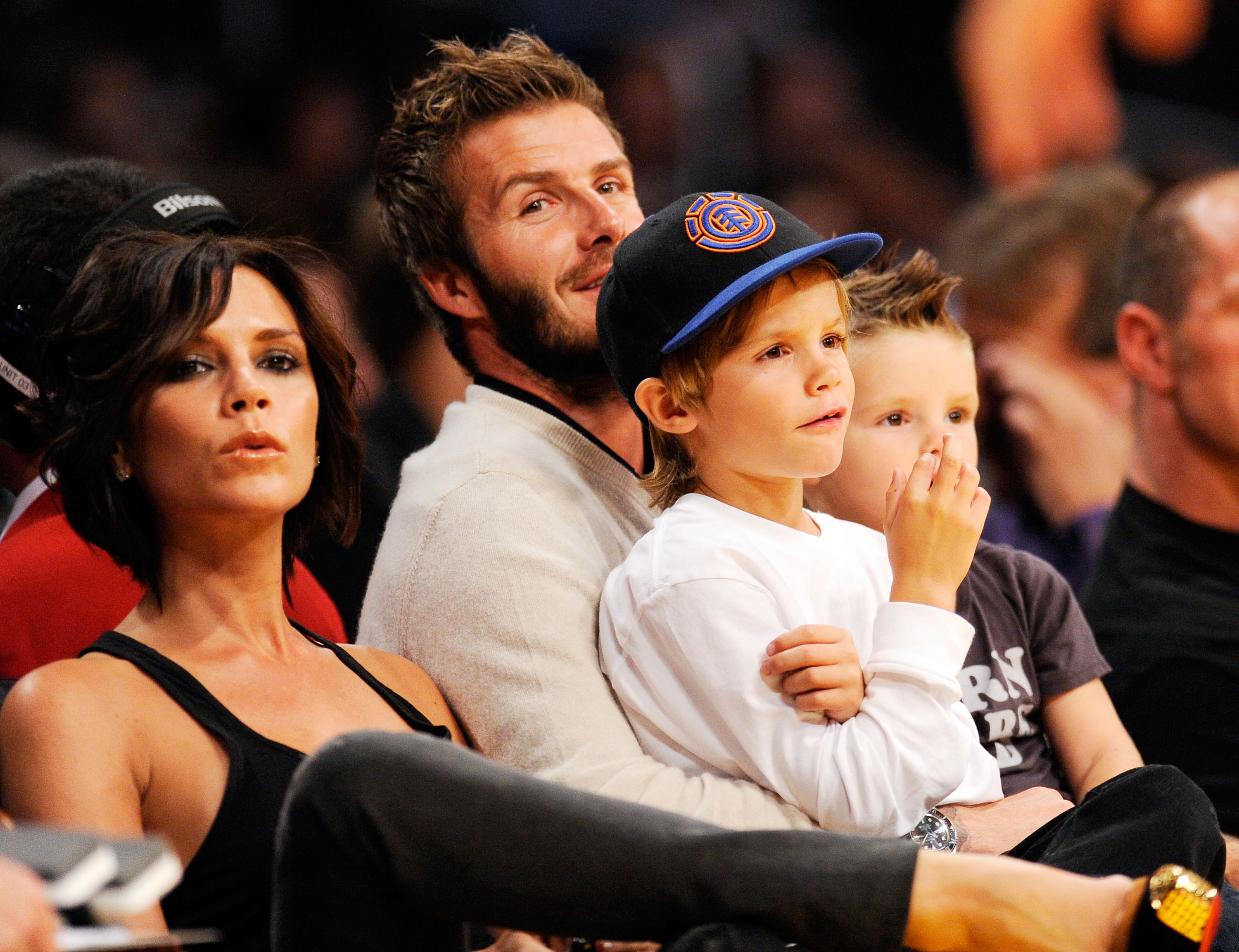 LOS ANGELES, CA - OCTOBER 30:  David Beckham and his wife Victoria follow the action between the Los Angeles Lakers and  the Dallas Mavericks along with their children Cruz, left, and Romeo, center right, at Staples Center on October 30, 2009 in Los Angel