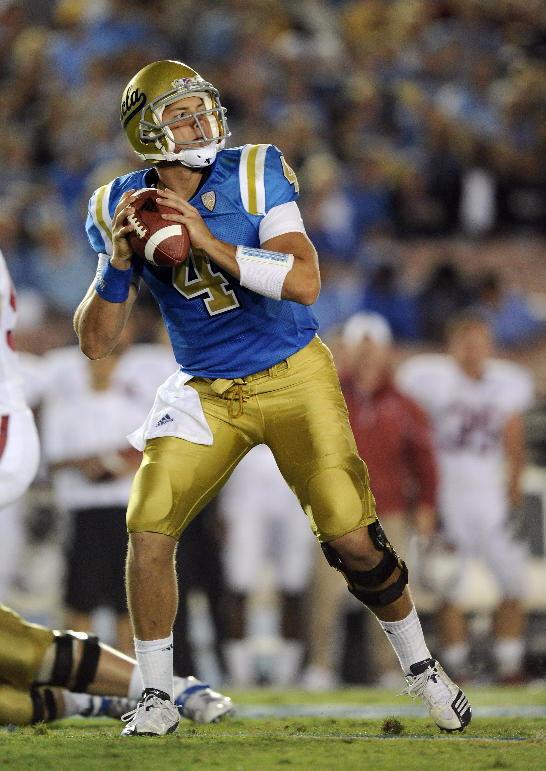 PASADENA, CA - SEPTEMBER 11:  Kevin Prince #4 of UCLA prepares to throw against Stanford during the first quarter at Rose Bowl on September 11, 2010 in Pasadena, California.  (Photo by Harry How/Getty Images)
