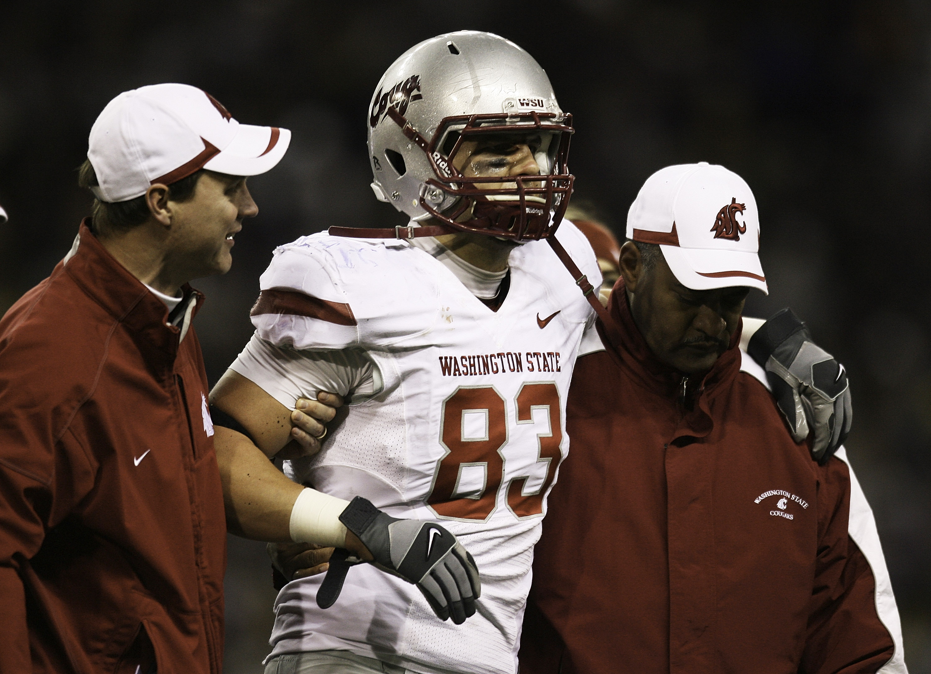 SEATTLE - NOVEMBER 28:  Tight end Zach Tatman #83 of the Washington State Cougars is helped off the field after being injured against the Washington Huskies on November 28, 2009 at Husky Stadium in Seattle, Washington. The Huskies defeated the Cougars 30-